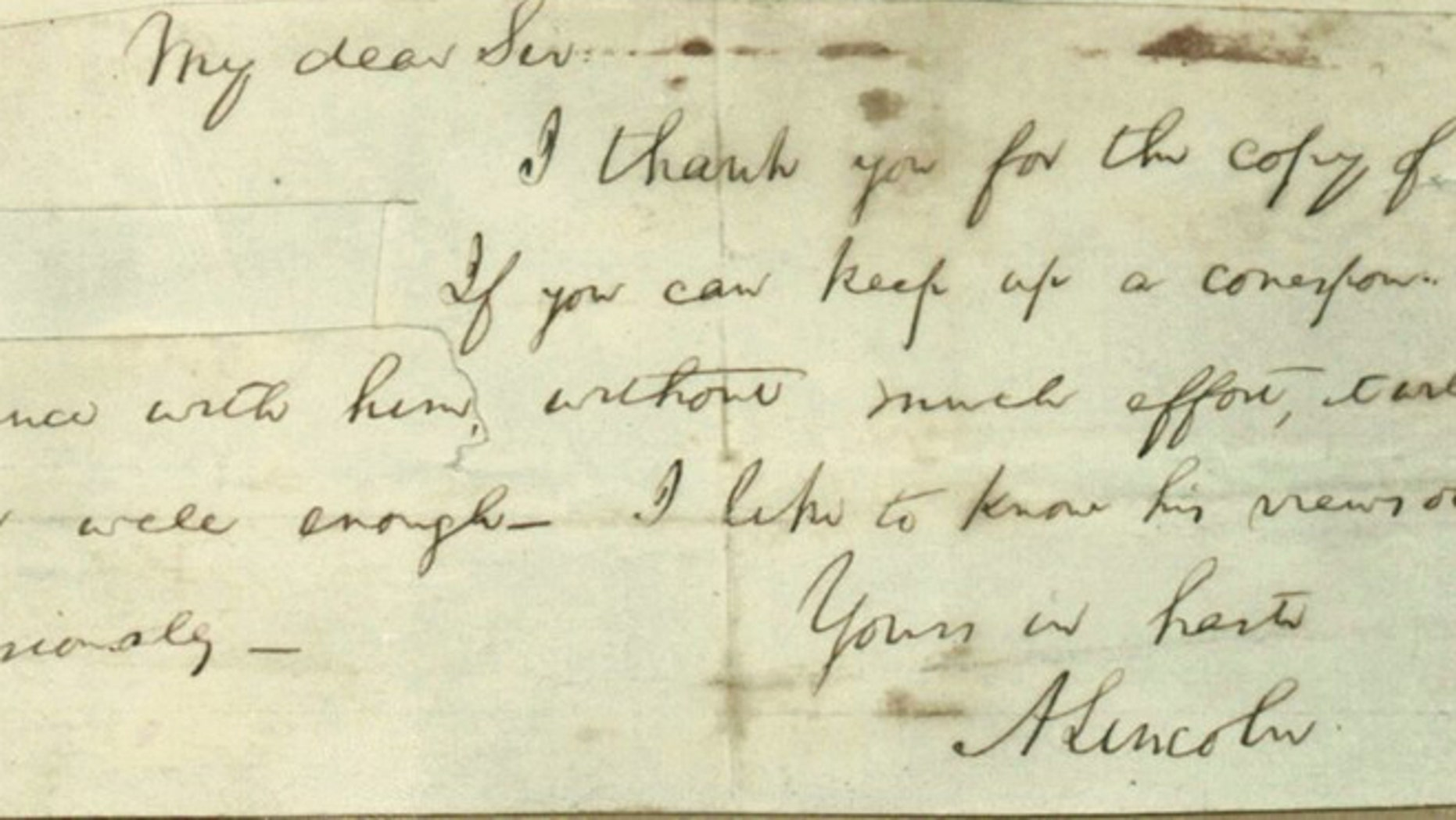 This photo provided by Papers of Abraham Lincoln project shows a note written by Abraham Lincoln.