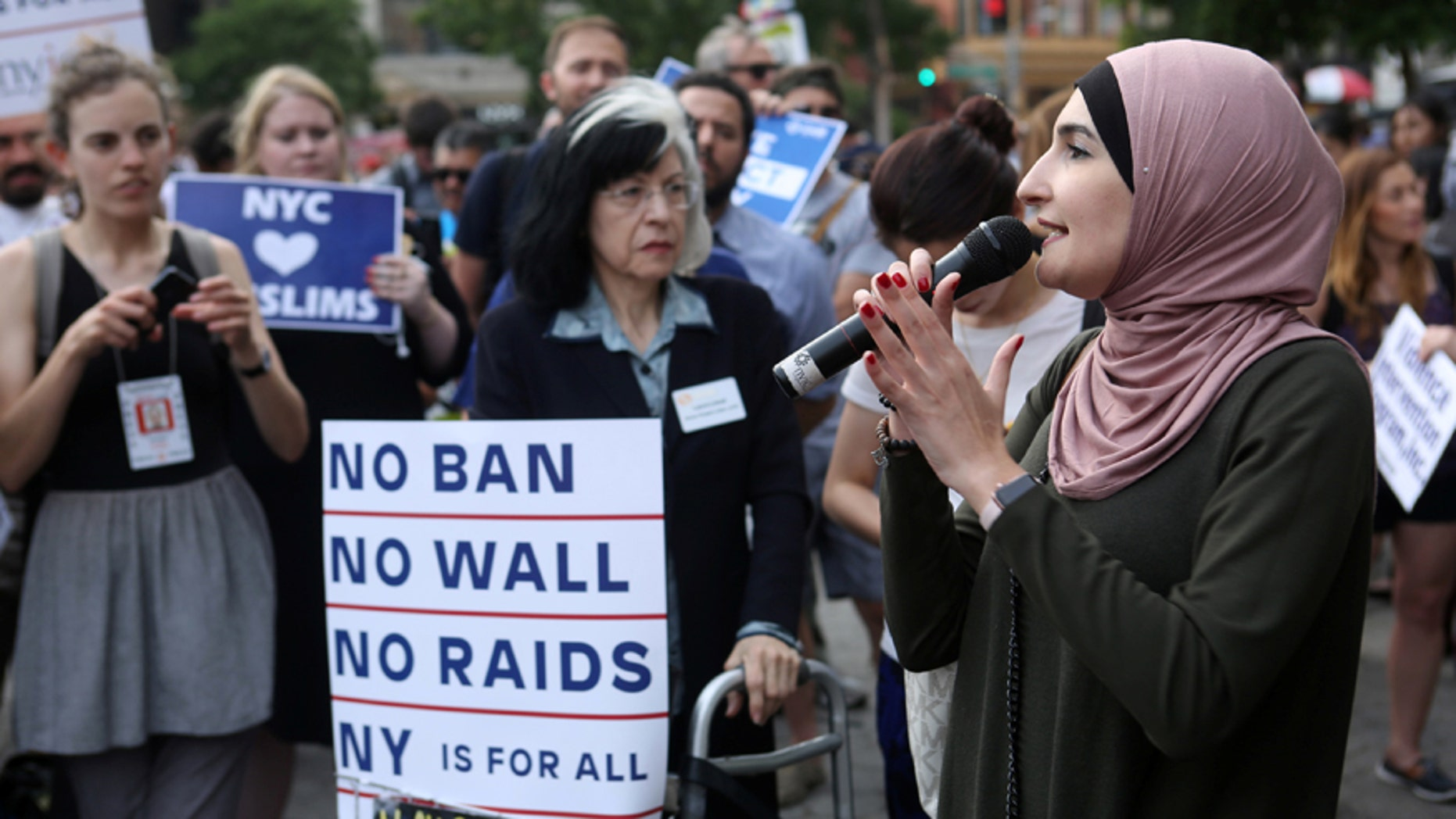 Activist Linda Sarsour speaks at a protest against U.S. President Donald Trump's limited travel ban, approved by the U.S. Supreme Court, in New York City, U.S., June 29, 2017. REUTERS/Joe Penney - RTS19726