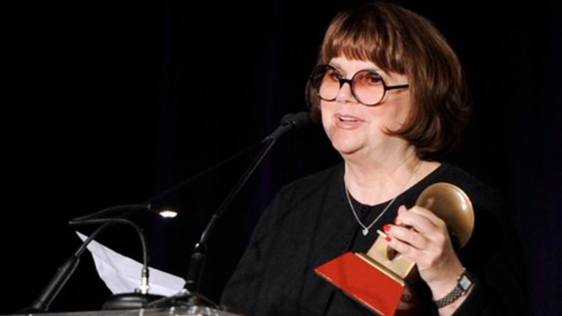 FILE: Nov. 9, 2011: Linda Ronstadt accepts the Life Time Achievement award at the Latin Recording Academy Lifetime Achievement Award and Trustees Award ceremony in Las Vegas.
