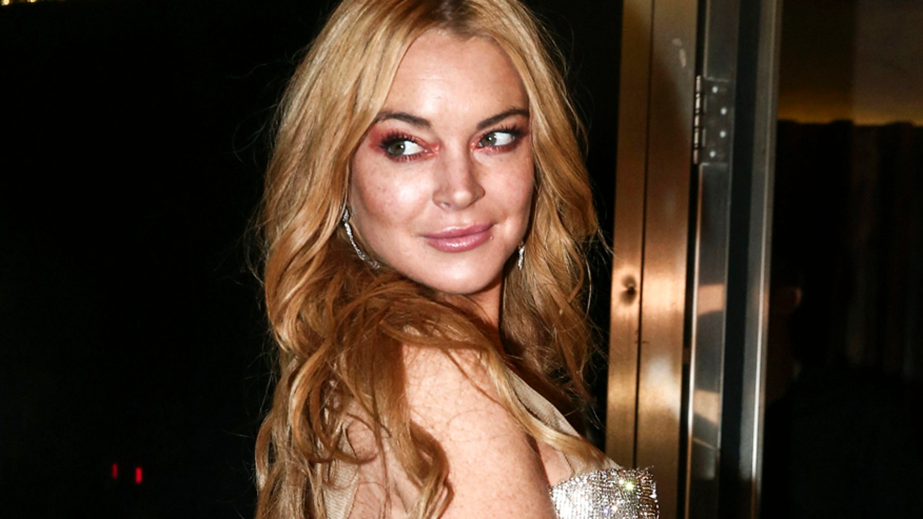 Lindsay Lohan owe back taxes to the government. Here the actress poses for photos at the entrance of the Lohan Nightclub  in Athens, Greece, October 2016.
