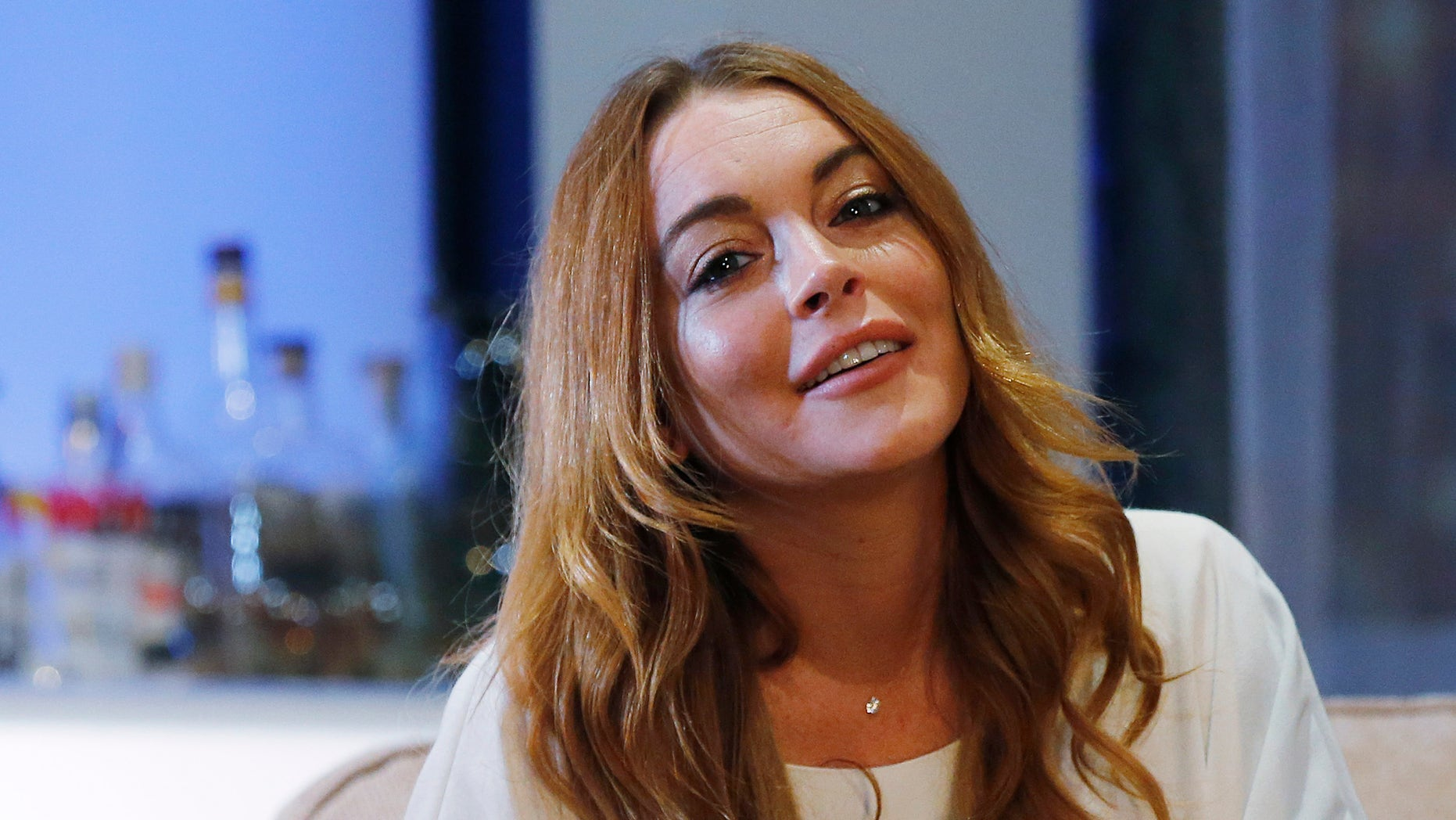 """September 30, 2014. Actress Lindsay Lohan rehearses a scene from """"Speed-the-Plow"""" by David Mamet at the Playhouse Theatre in London."""