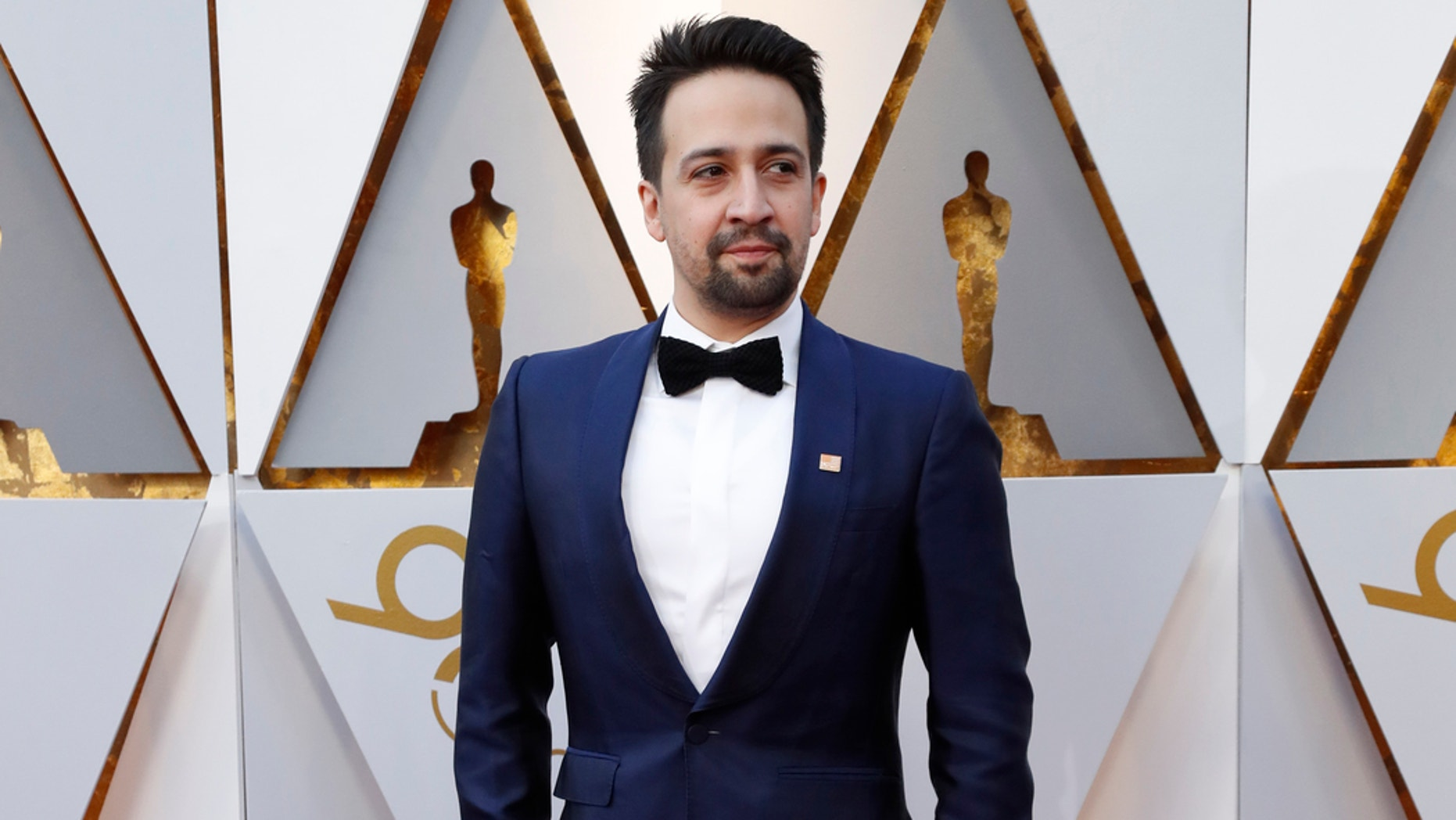 Lin Manuel Miranda sports an orange Everytown pin at the 90th Academy Awards to advocates for stronger gun control.
