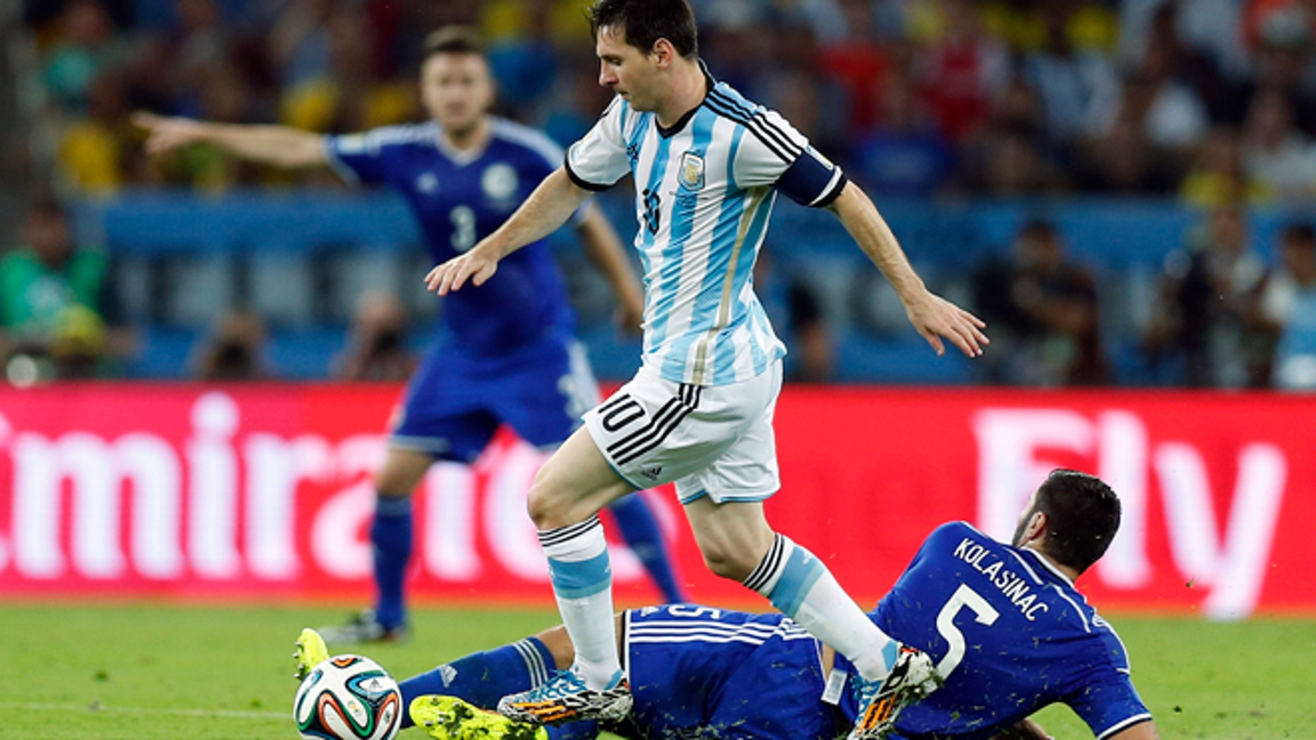 June 15, 2014: Argentina's Lionel Messi strolls past Bosnia's Sead Kolasinac during the group F World Cup soccer match between Argentina and Bosnia at the Maracana Stadium in Rio de Janeiro, Brazil.