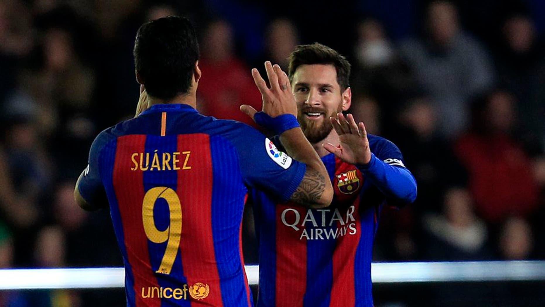 FC Barcelona's Lionel Messi, right, celebrates after scoring with his teammate Luis Suarez during the Spanish La Liga soccer match between Villarreal and Barcelona at the Ceramica stadium in Villarreal, Spain, Sunday, Jan. 8, 2017. (AP Photo/Alberto Saiz)