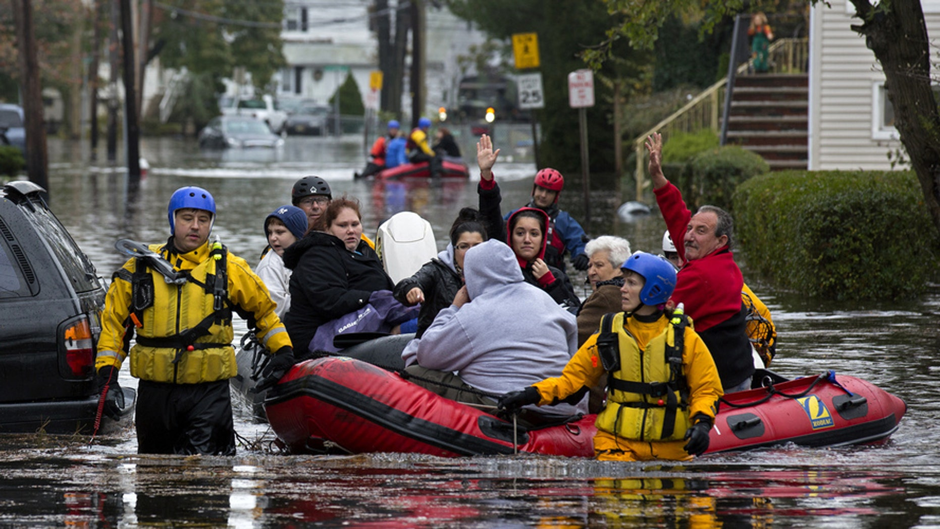 Oct. 2012: The death toll is expected to rise before first responders,such as these in Little Ferry, NJ, can make rescue efforts.