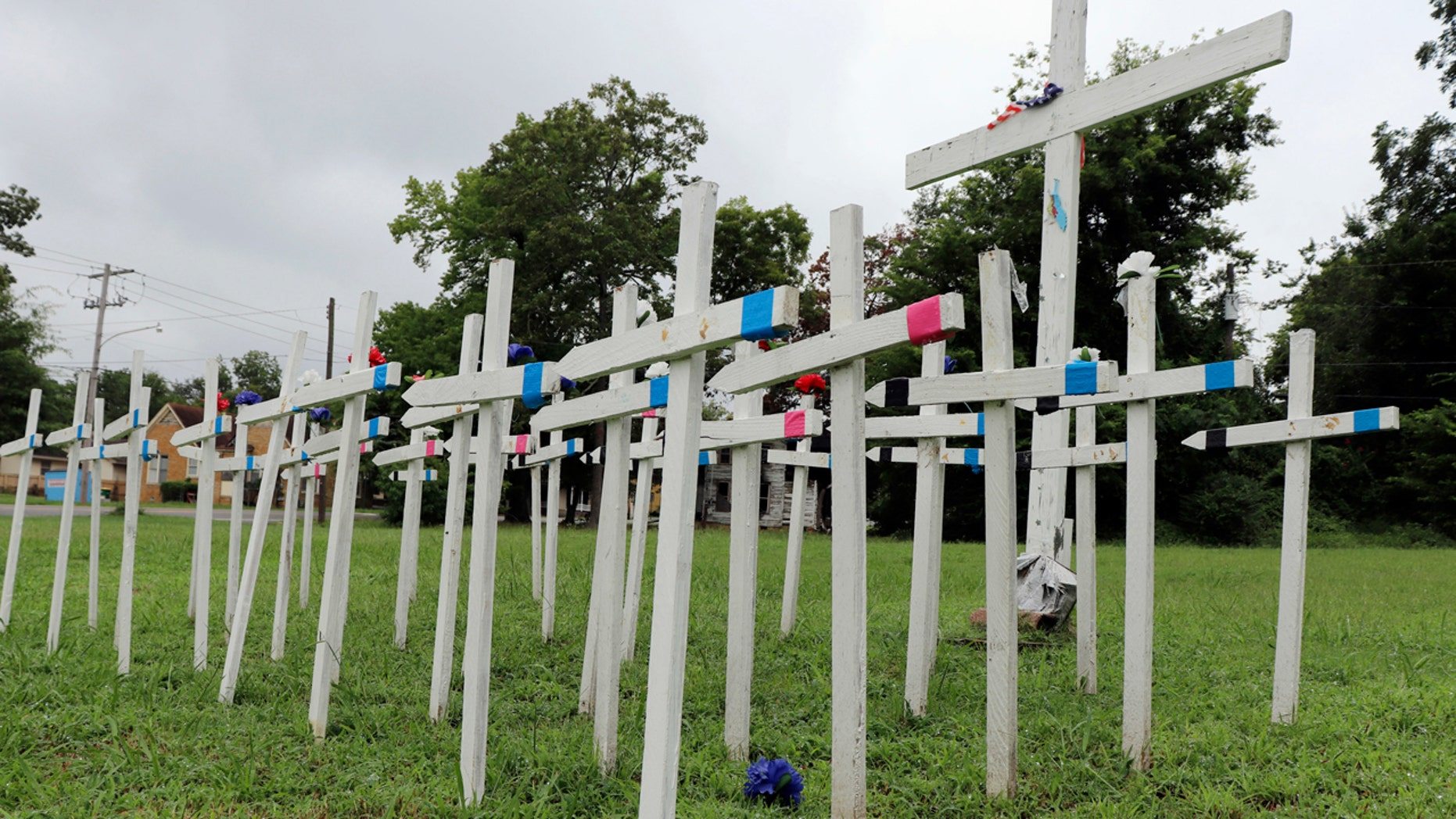 An impromptu memorial filled with crosses sits in a vacant lot near the state Capitol building in Little Rock.
