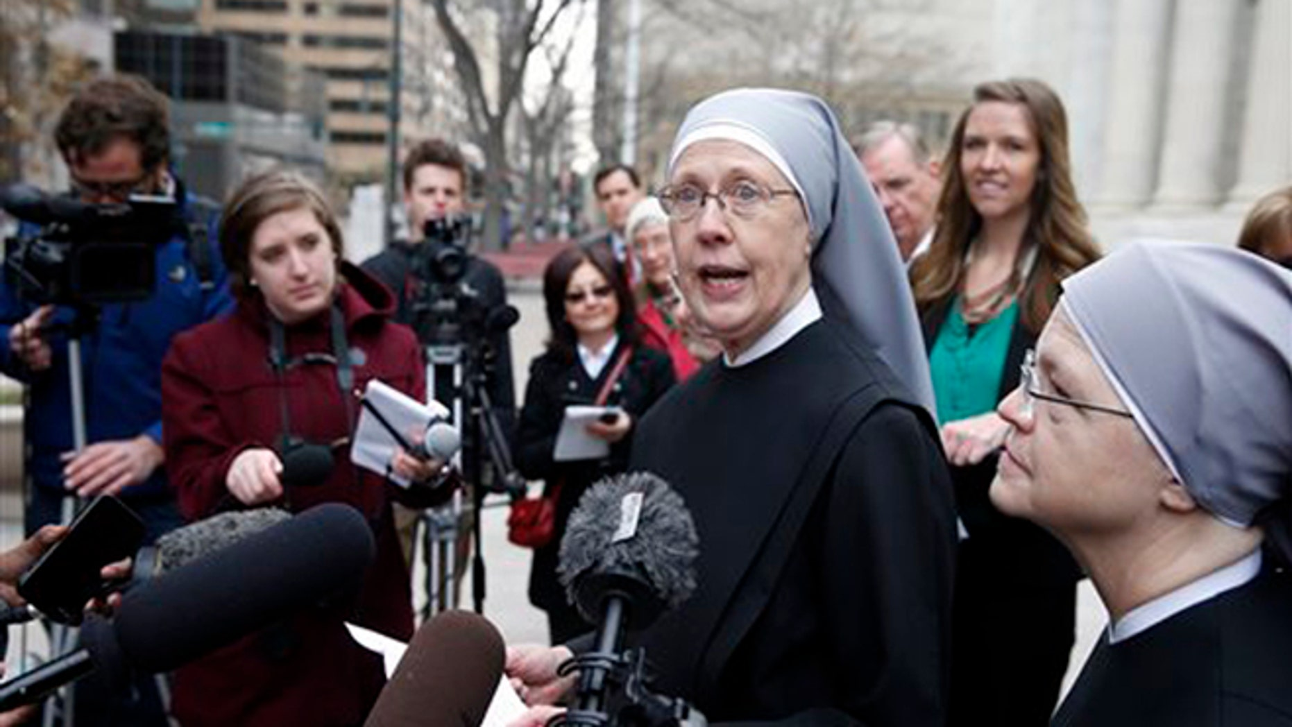In this Dec. 8, 2014, file photo, Sister Loraine Marie Maguire, of Little Sisters of the Poor, speaks to members of the media after attending a hearing in the 10th U.S. Circuit Court of Appeals, in Denver, Colo.