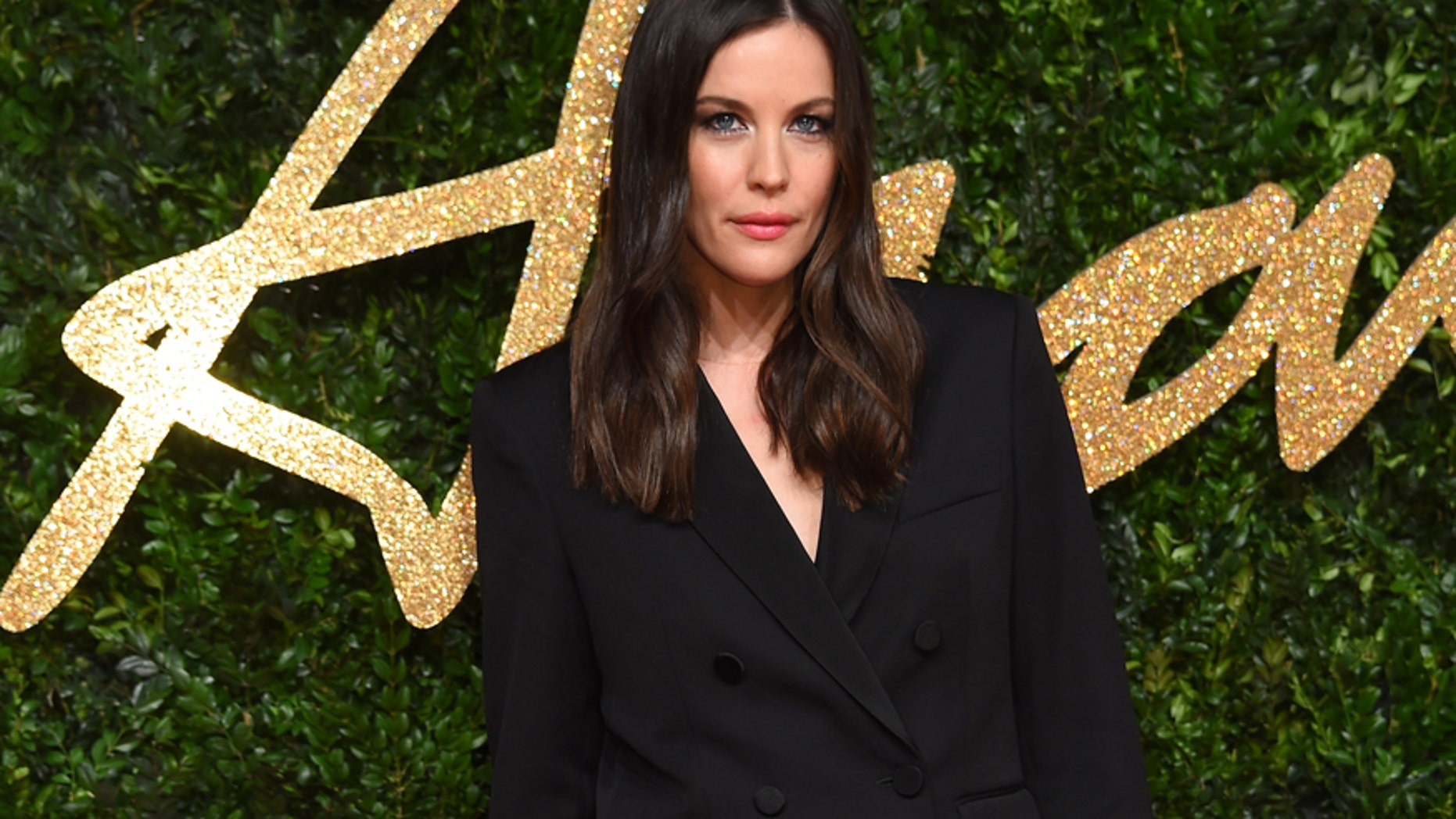 Liv Tyler poses for photographers upon arrival at the British Fashion Awards 2015 in London, Monday, Nov. 23, 2015.