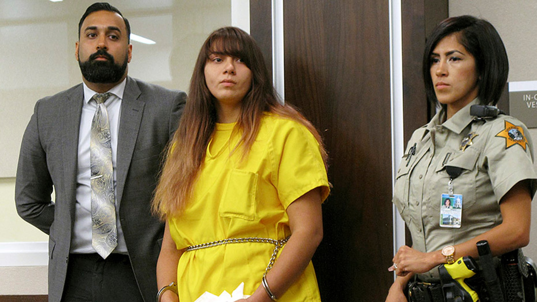 FILE - In this July 28, 2017 file photo, Obdulia Sanchez, 18, middle, appears in a Los Banos, Calif., branch of the Merced County Superior Court with her public defender, Ramnik Samrao. In a court appearance Friday, Aug. 11, 2017, her attorney said Sanchez, accused of driving drunk while livestreaming the July 21, 2017 crash that killed her younger sister, said a mechanical problem may have caused the accident. (AP Photo/Scott Smith, File)