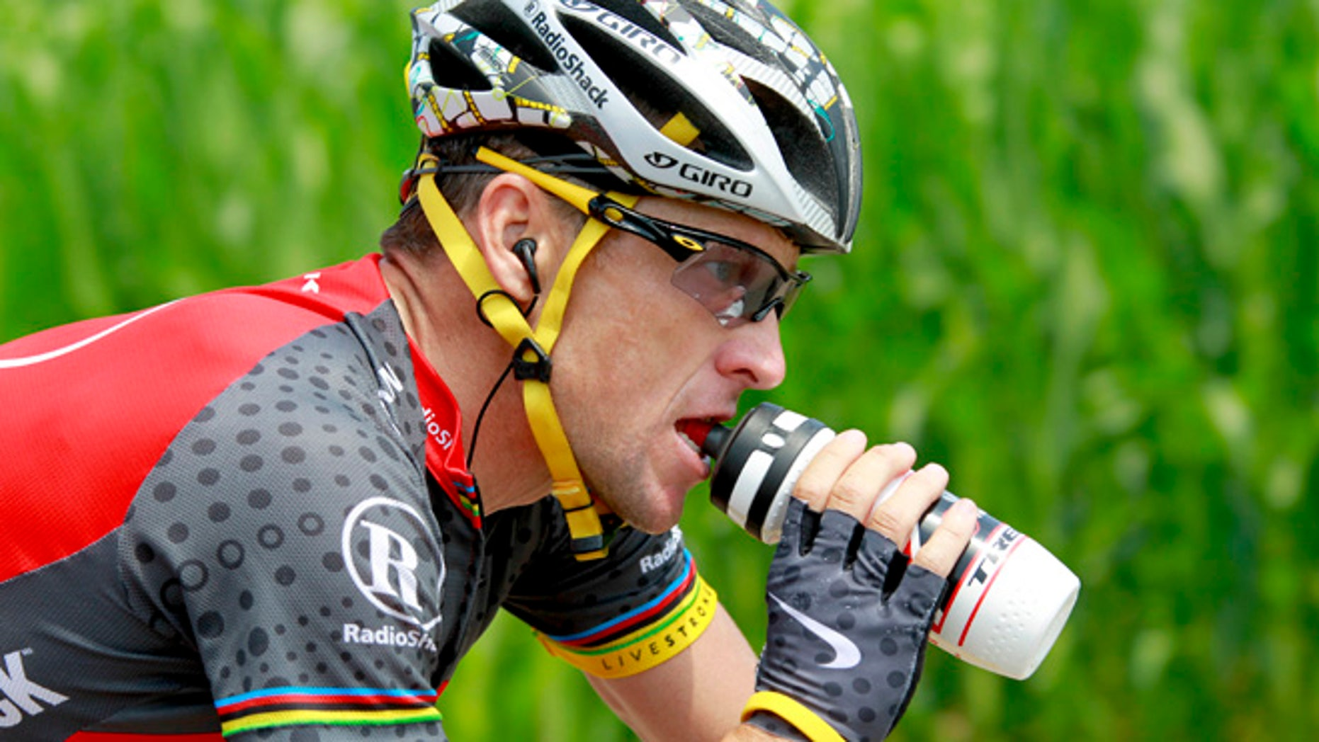 July 10, 2010: In this file photo, Lance Armstrong drinks during the seventh stage of the Tour de France cycling race from Tournus and to Station des Rousses, France. Nike Inc. is cutting ties with the Livestrong cancer charity. The move by the sports company ends a nine-year relationship that helped the foundation raise more than $100 million and made the charity's signature yellow wristband an international symbol for cancer survivors.