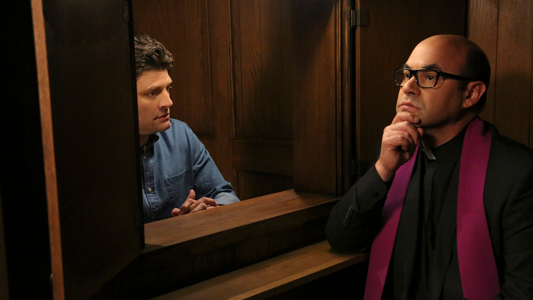 Pilot -- Upon learning that Lesley is expecting, Chip goes to the bookstore seeking parenting guidance, and stumbles upon a bible which inspires him to begin living strictly by the book, on the series premiere of LIVING BIBLICALLY, Monday, Feb 26 (9:30-10:00 PM, ET/PT) on the CBS Television Network.  Pictured L-R: Jay R. Ferguson as Chip and Ian Gomez as Father Gene Photo: Michael Yarish/CBS ©2017 CBS Broadcasting, Inc. All Rights Reserved