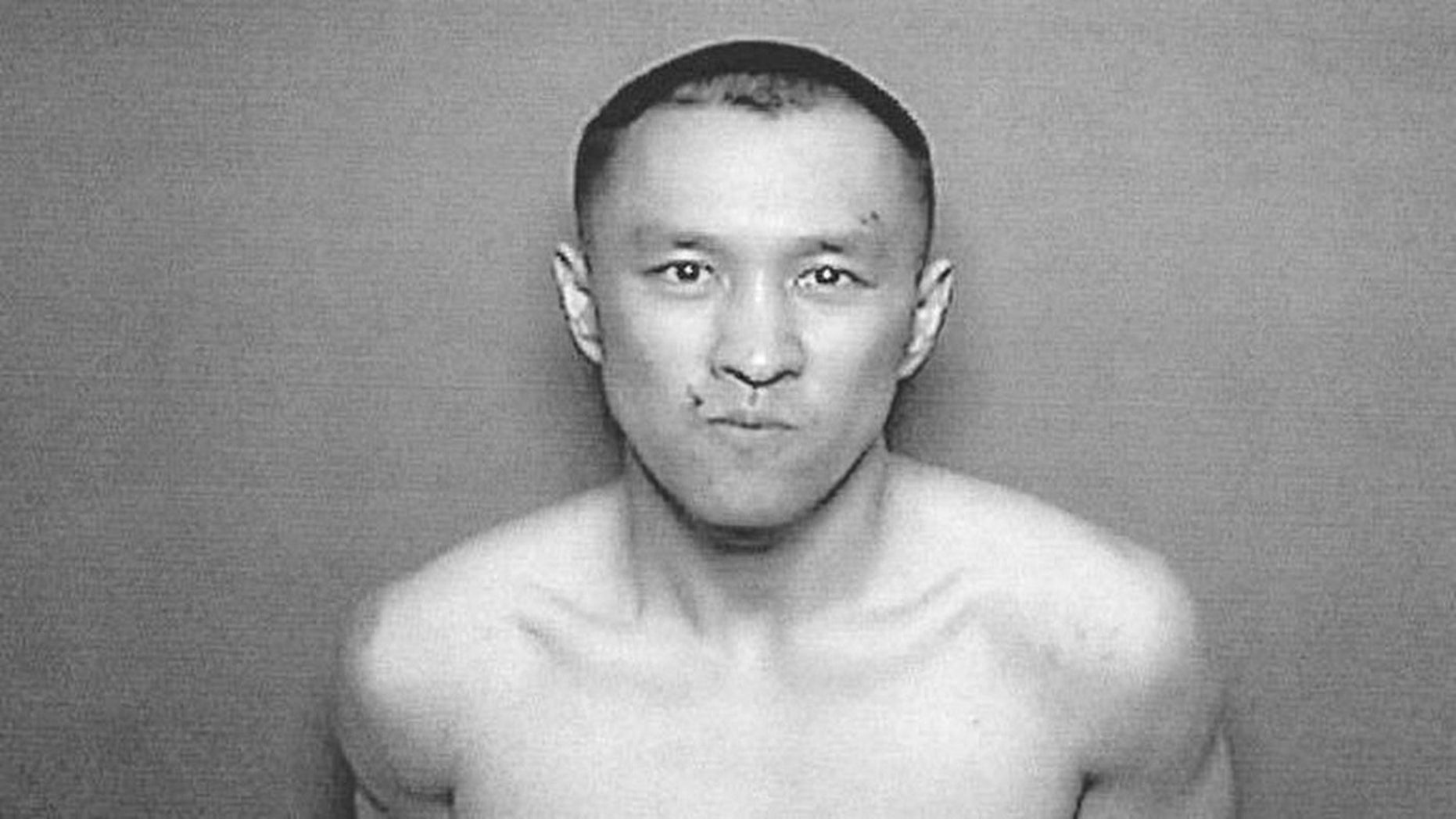 Yihong Peng, 30, was booked on murder charges Friday for the fatal stabbing of his mother and critical injury of his father.