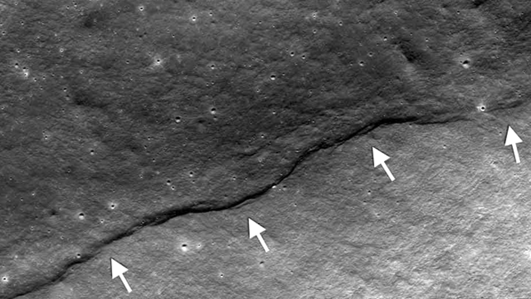 By analyzing new photos of faults such as this on the moon, scientists have concluded that our nearest heavenly body is shrinking.
