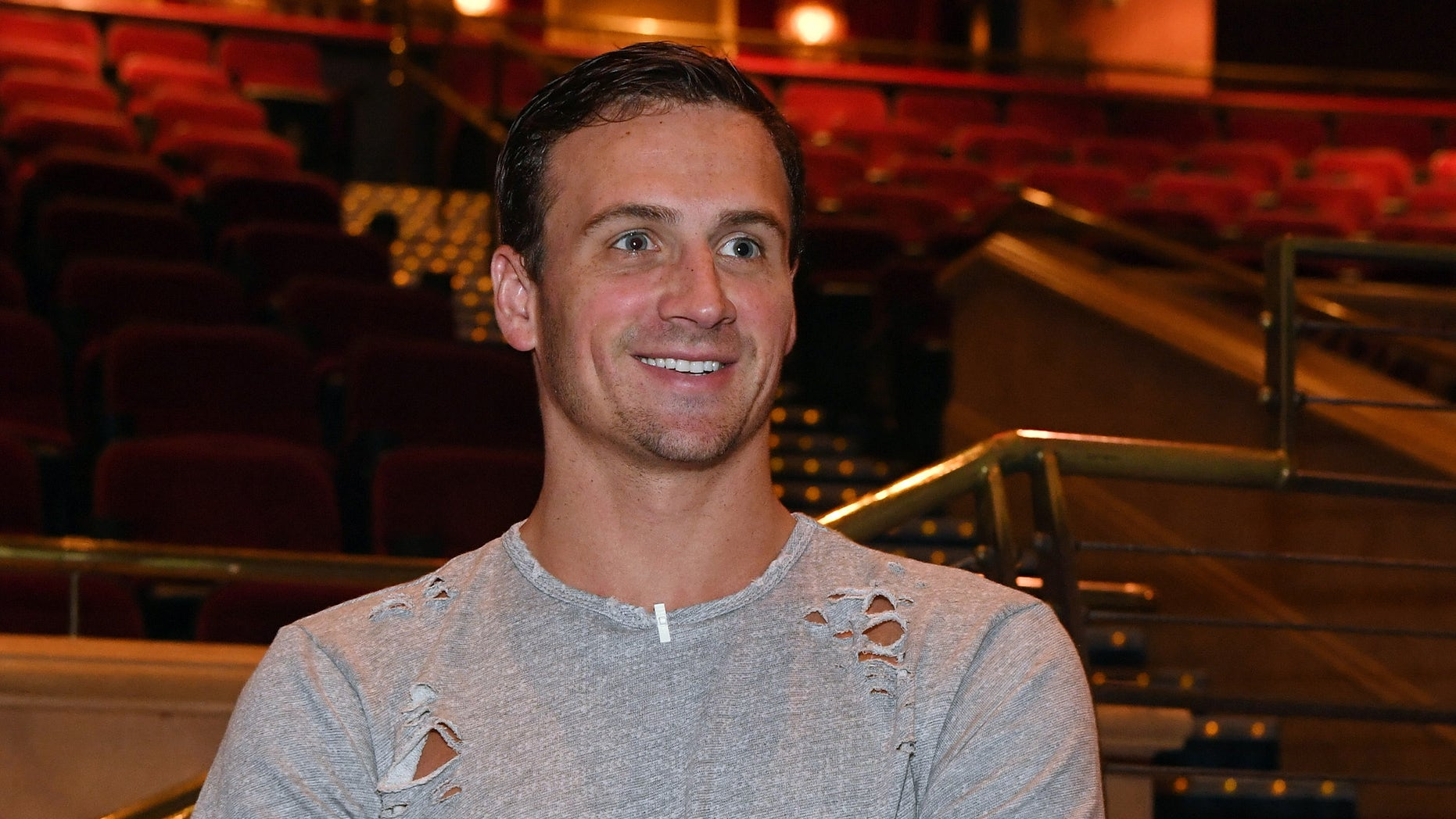 """LAS VEGAS, NV - SEPTEMBER 30:  Olympian Ryan Lochte looks at the """"O"""" theater as he and dancer Cheryl Burke arrive at a rehearsal for their """"Dancing with the Stars"""" performance with the cast of """"O by Cirque du Soleil"""" at the Bellagio on September 30, 2016 in Las Vegas, Nevada.  (Photo by Ethan Miller/Getty Images for Cirque du Soleil)"""