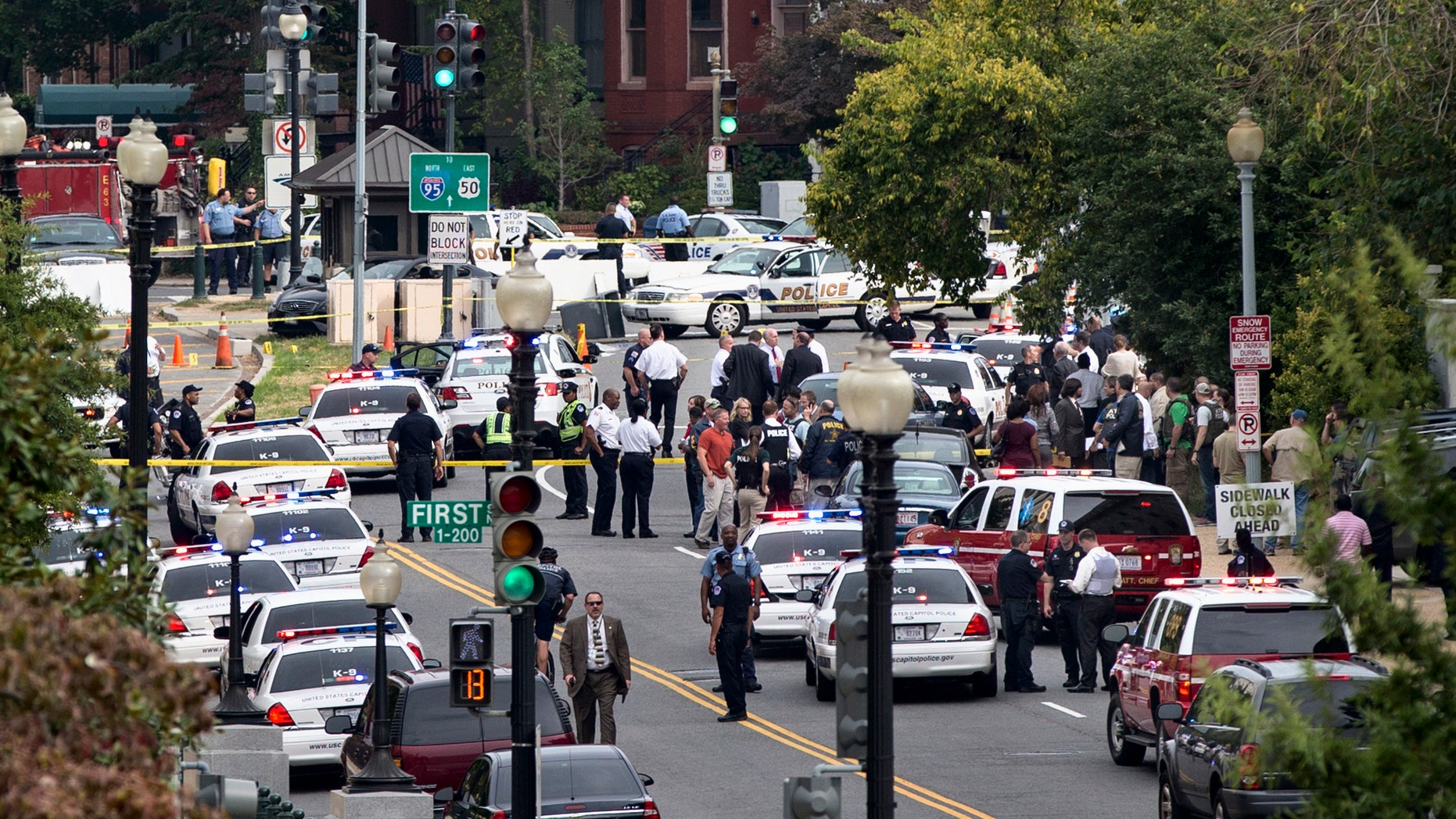 This view is from the Russell Senate Office Building shows police converging on the scene of a shooting on Constitution Avenue on Capitol and near the Supreme Court in Washington, Thursday, Oct. 3, 2013.