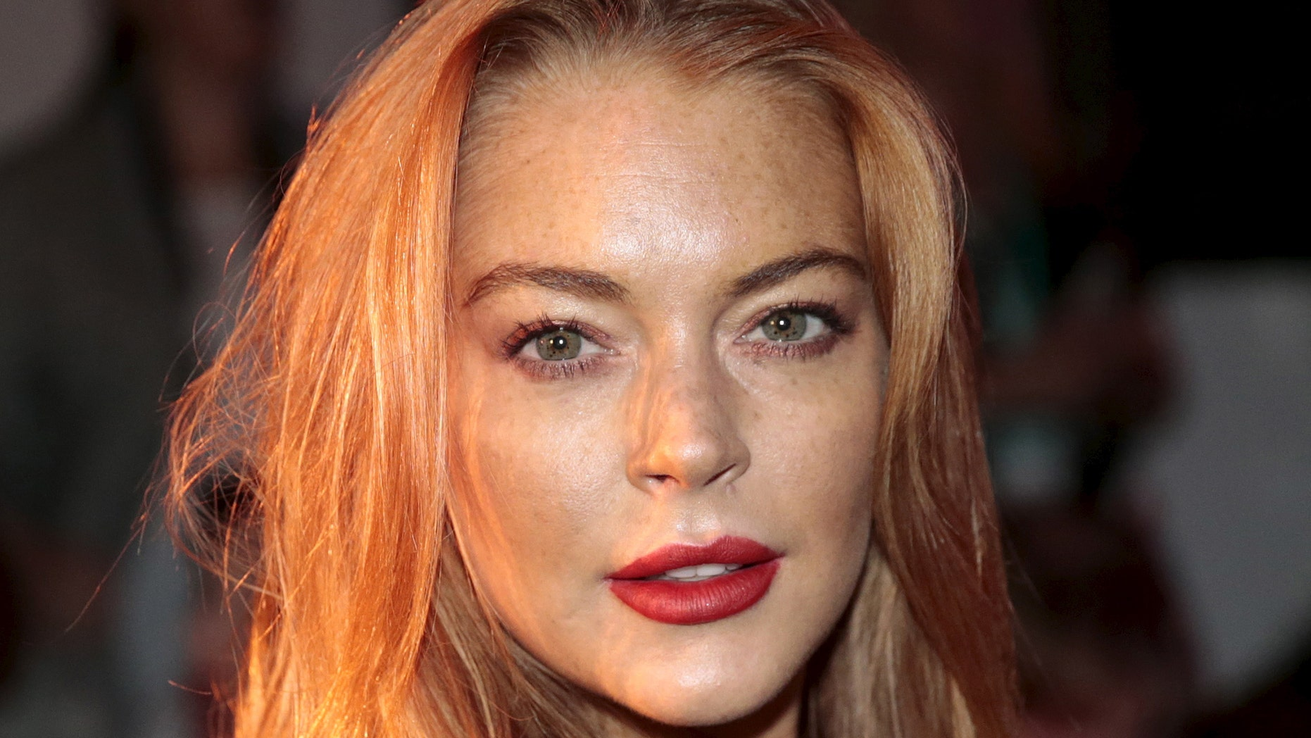 September 19, 2015.  Lindsay Lohan arrives for the presentation of the  Gareth Pugh Spring/Summer 2016 collection during London Fashion Week in London, Britain.