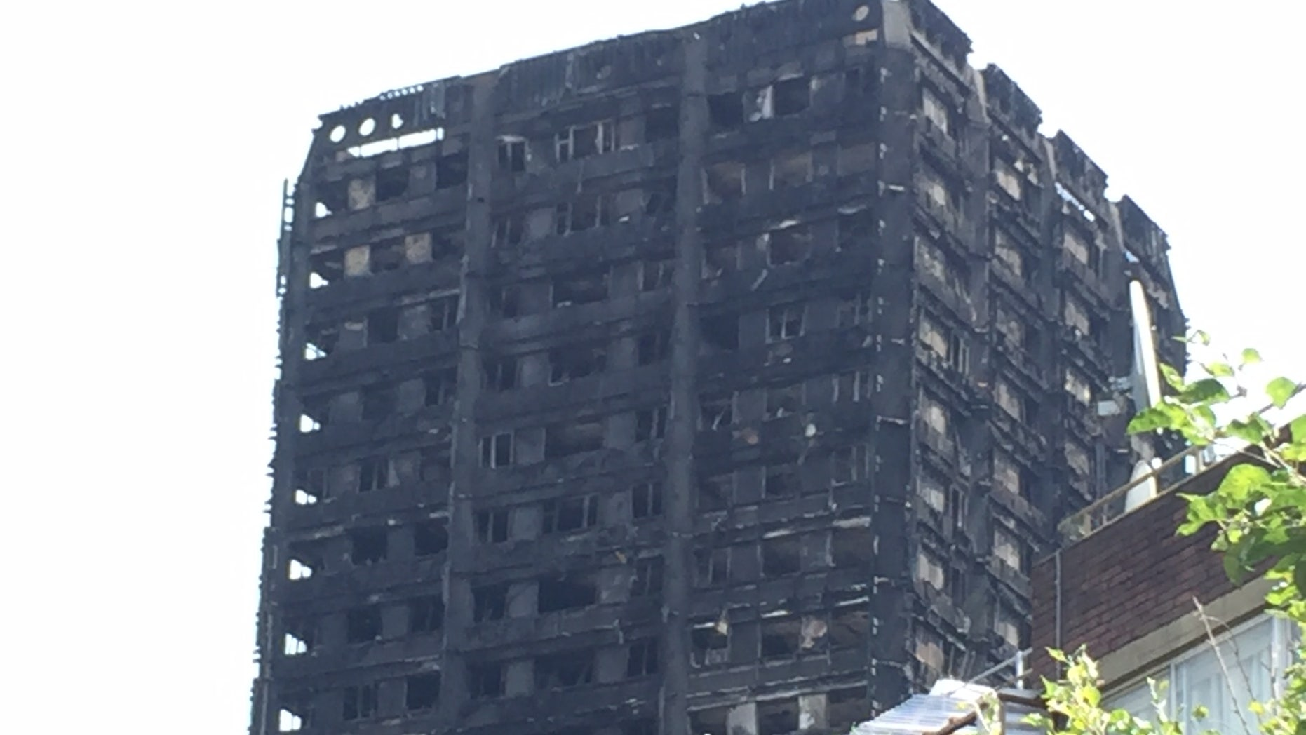 The 24-story building may have gone up in flames because of shortcuts in safety measures.