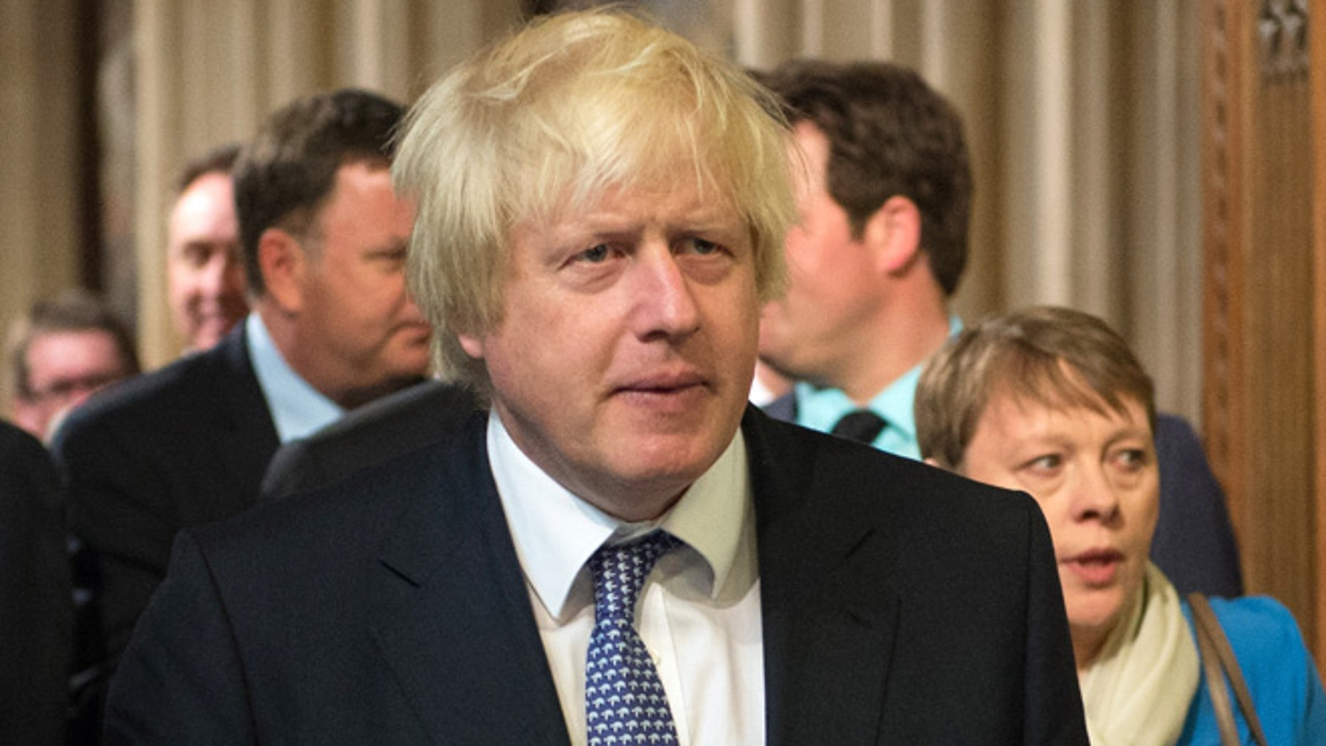 May 27, 2015: The Mayor of London and Conservative Party MP Boris Johnson arrives in the House of Commons chamber following the State Opening of Parliament at the Palace of Westminster in London, Britain.