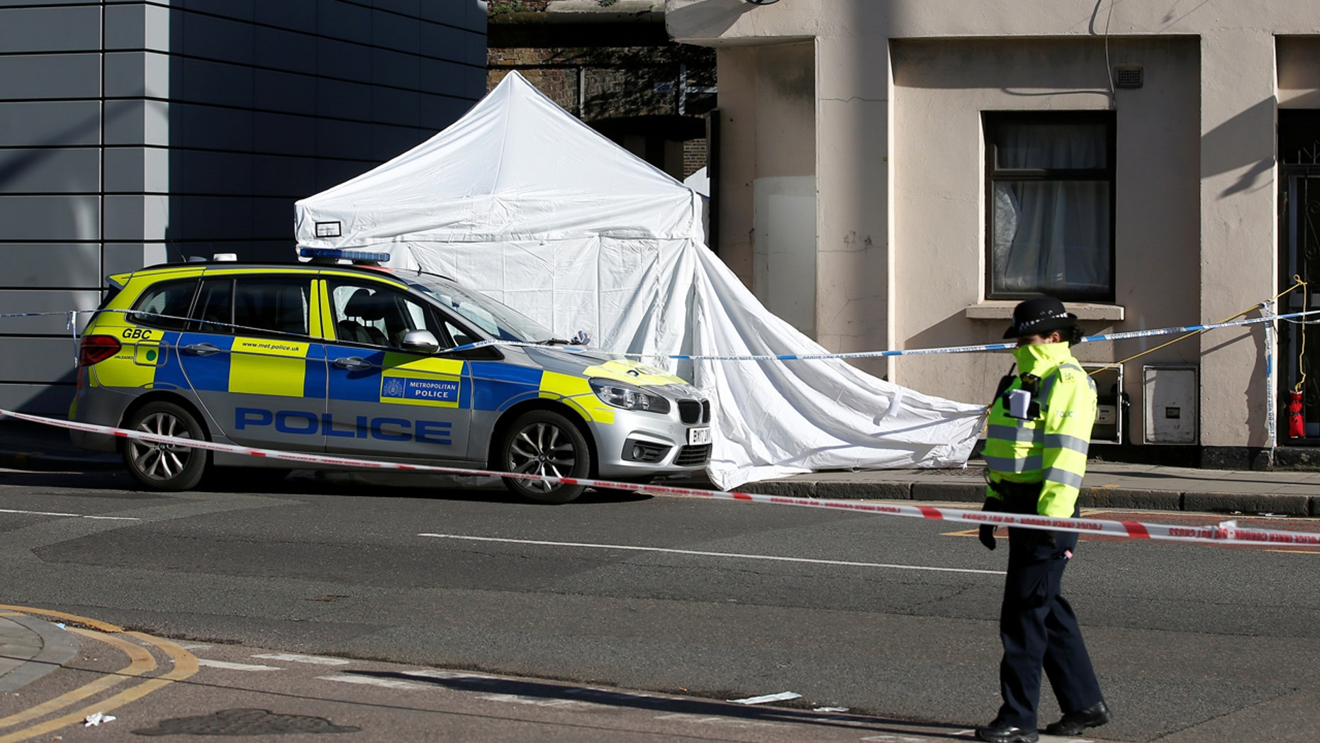A police officer stands guard at the scene where a man died from stab wounds on the night of April 4, 2018, on Link Street in east London, Britain, April 5, 2018.