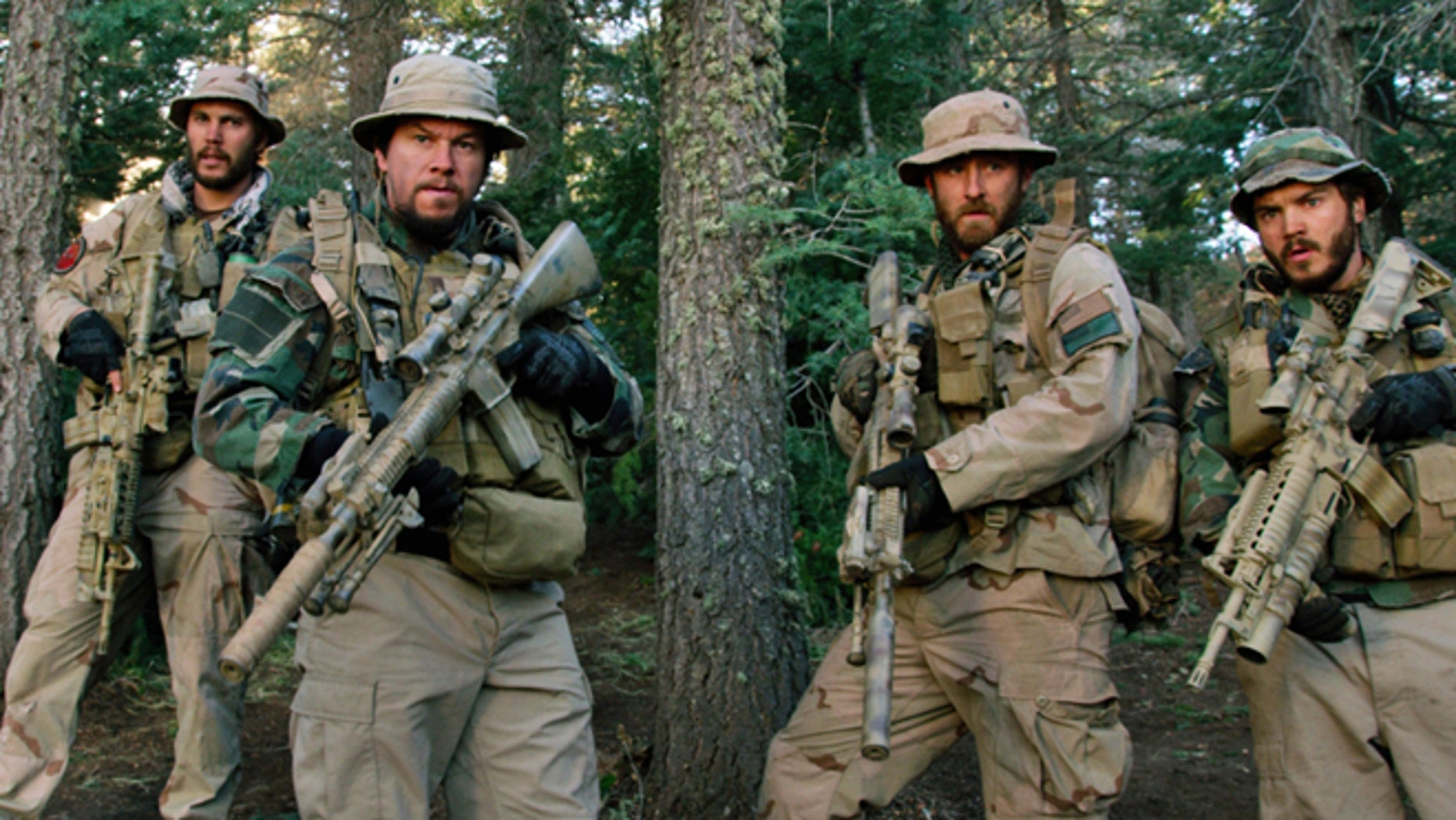 "FILE: From left, Taylor Kitsch, as Michael Murphy, Mark Wahlberg as Marcus Luttrell, Ben Foster as Matt Axe Axelson, and Emile Hirsch as Danny Dietz in a scene from the film ""Lone Survivor."""
