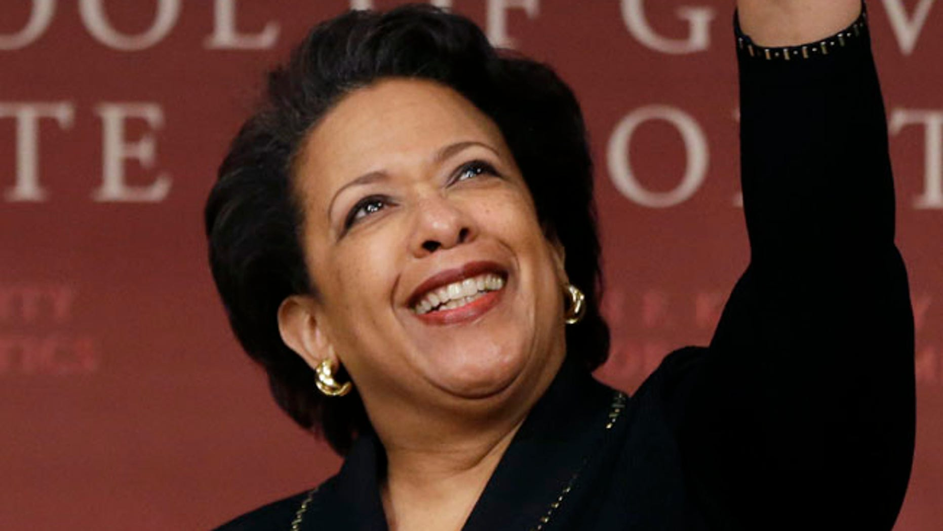 Former U.S. Attorney General Loretta Lynch, the nation's first black woman to head the Justice Department, waves as she arrives to speak at a conference on policy and blacks at Harvard University's Kennedy School of Government, Friday, April 7, 2017, in Cambridge, Mass. The 57-year-old North Carolina native graduated from Harvard College in 1981 and from Harvard Law School in 1984. (AP Photo/Elise Amendola)