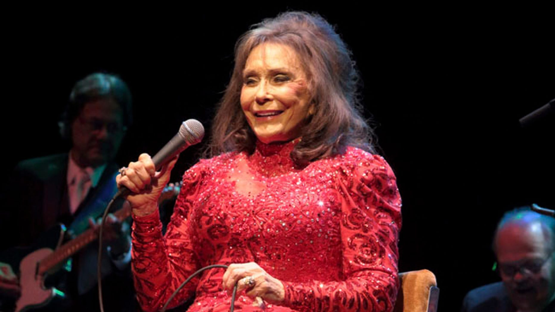 FILE - In this Aug. 28, 2016 file photo, Loretta Lynn performs in concert at the American Music Theater in Lancaster, Pa. A posting on country music legend Lynn's website says she has been hospitalized after having a stroke. The posting says Lynn was admitted into a Nashville hospital on Thursday night, May 4, 2017, after suffering the stroke at her home in Hurricane Mills, Tenn. (Photo by Owen Sweeney/Invision/AP, File)