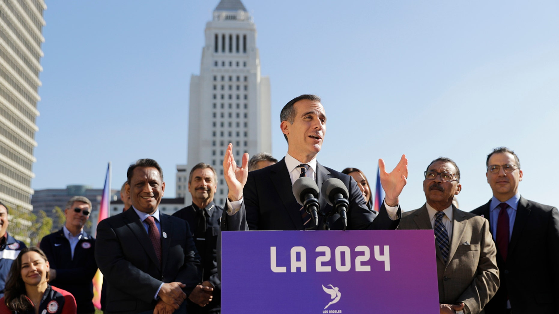 Los Angeles Mayor Eric Garcetti, center, speaks during a news conference Wednesday, Jan. 25, 2017, in Los Angeles.
