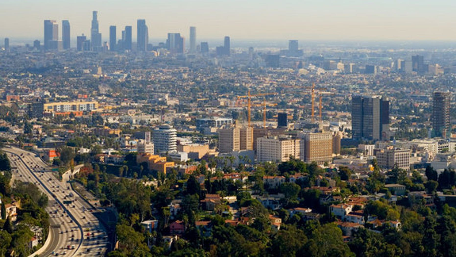 The skyline of Los Angeles with a layer of smog hanging over the city.