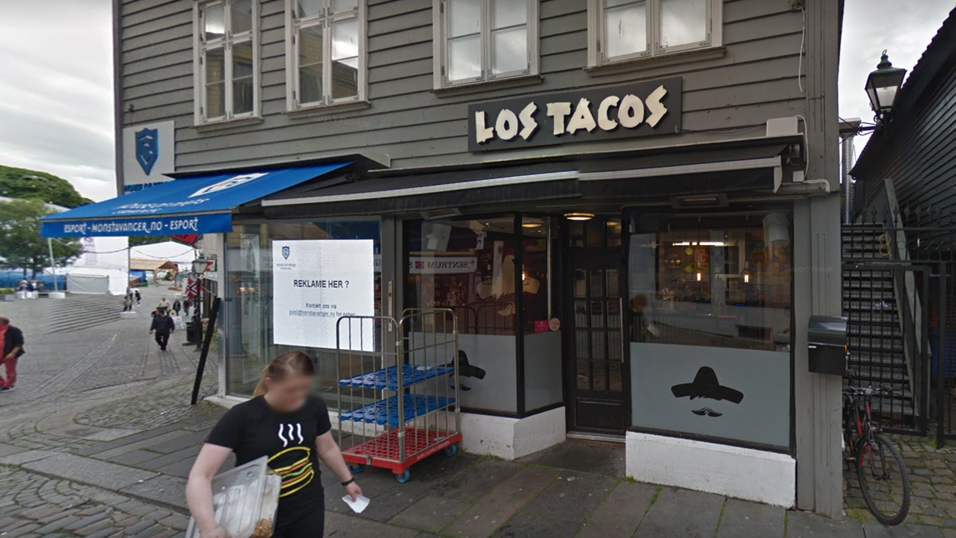 A new location of Los Tacos in Norway is trolling Trump with its window sign.