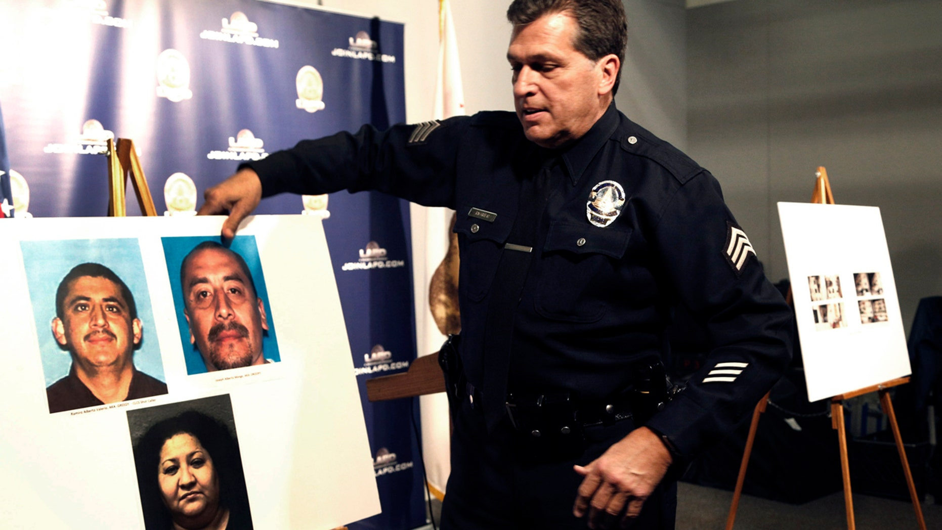 Feb. 6, 2017: Los Angeles police Sgt. Jack Richter displays photos of arson suspects from a 1993 fire prior to a news conference in Los Angeles