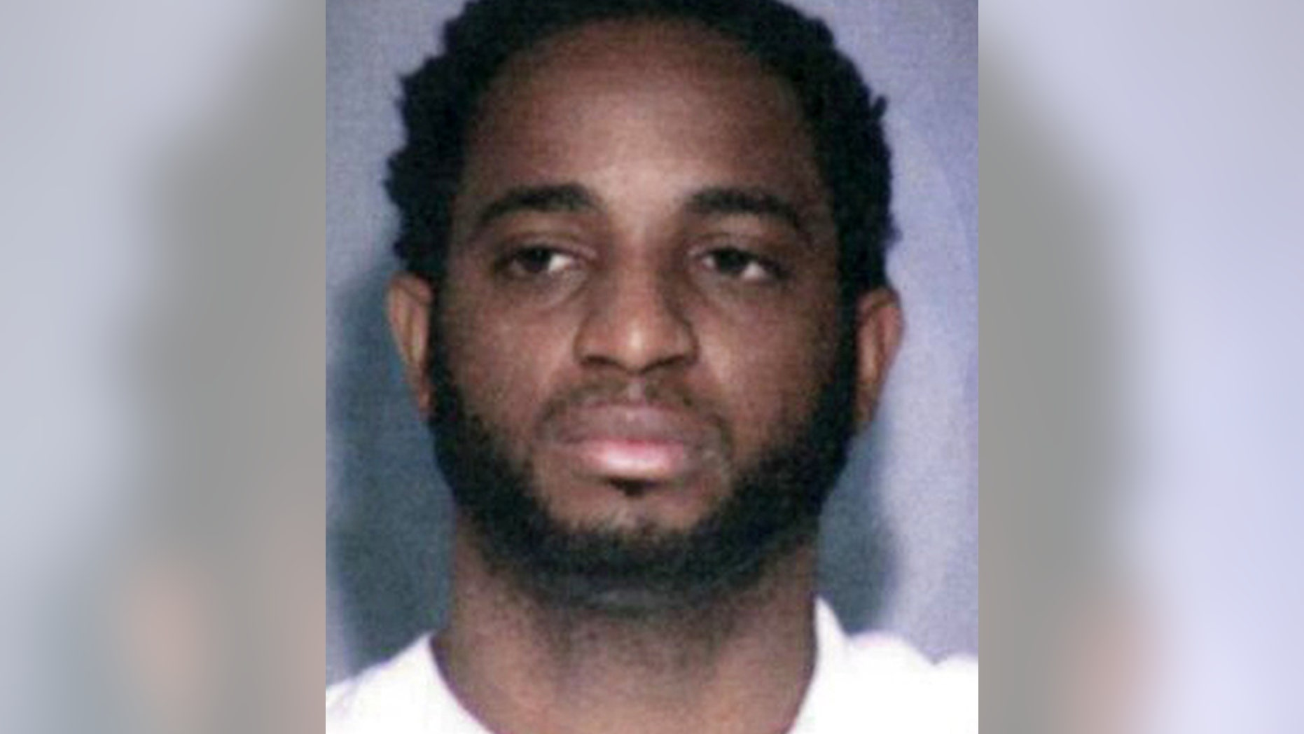 This undated photo provided by the FBI shows fugitive Marlon Jones who is wanted for multiple counts of murder in Los Angeles.