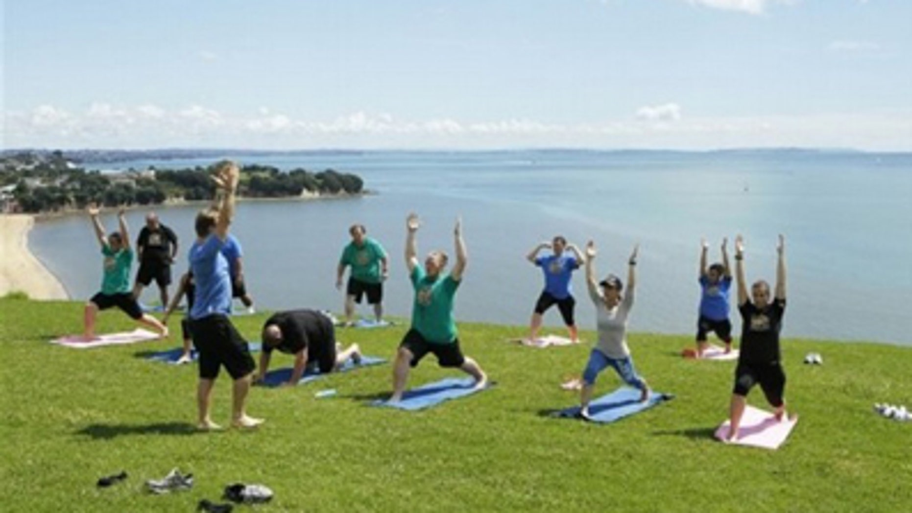 """Celebrity trainers Bob Harper and Jillian Michaels lead contestants from NBC's """"The Biggest Loser"""" in a yoga workout against the picturesque backdrop of Auckland, New Zealand. The show recently filmed two special New Zealand episodes in the youngest country on earth."""