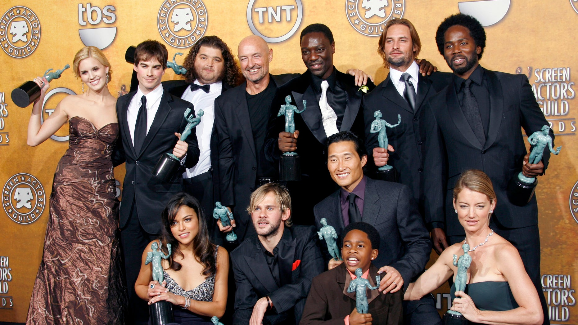 "The cast of the series ""Lost"" celebrate with their trophies backstage for their win in the category of outstanding performance by an ensemble in a drama series at the 12th annual Screen Actors Guild Awards in Los Angeles, California Jan. 29, 2006."
