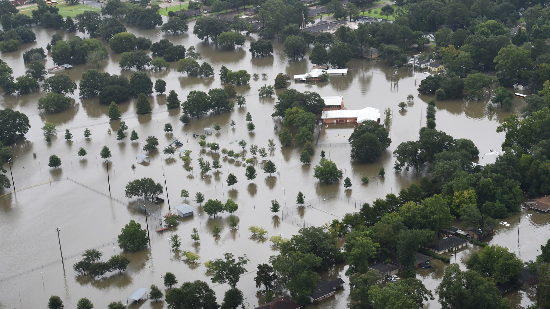 This aerial image shows flooded areas of North Baton Rouge, La., Saturday, Aug. 13, 2016. (Patrick Dennis/The Advocate via AP)