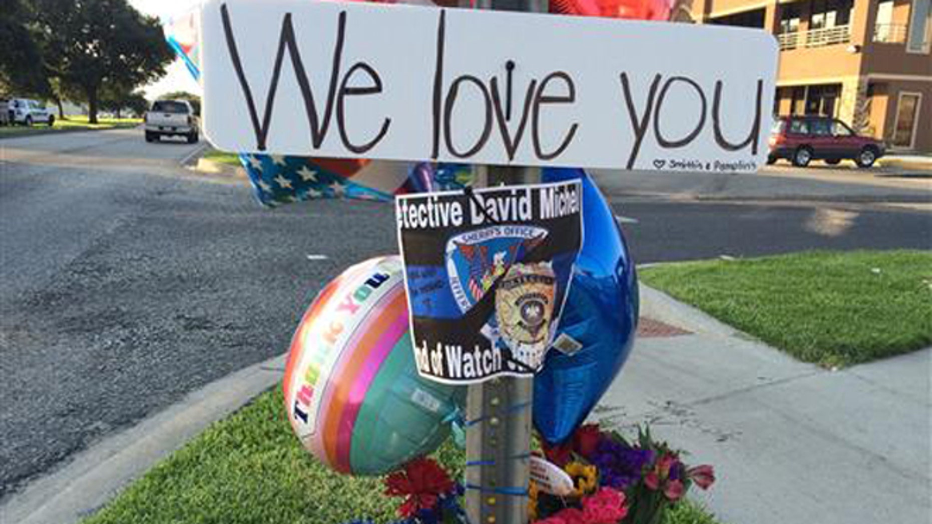 June 22, 2016: Flowers and other items are laid at a memorial where Jefferson Parish Sheriff's Deputy David F. Michel Jr. was shot and killed in Harvey, La.
