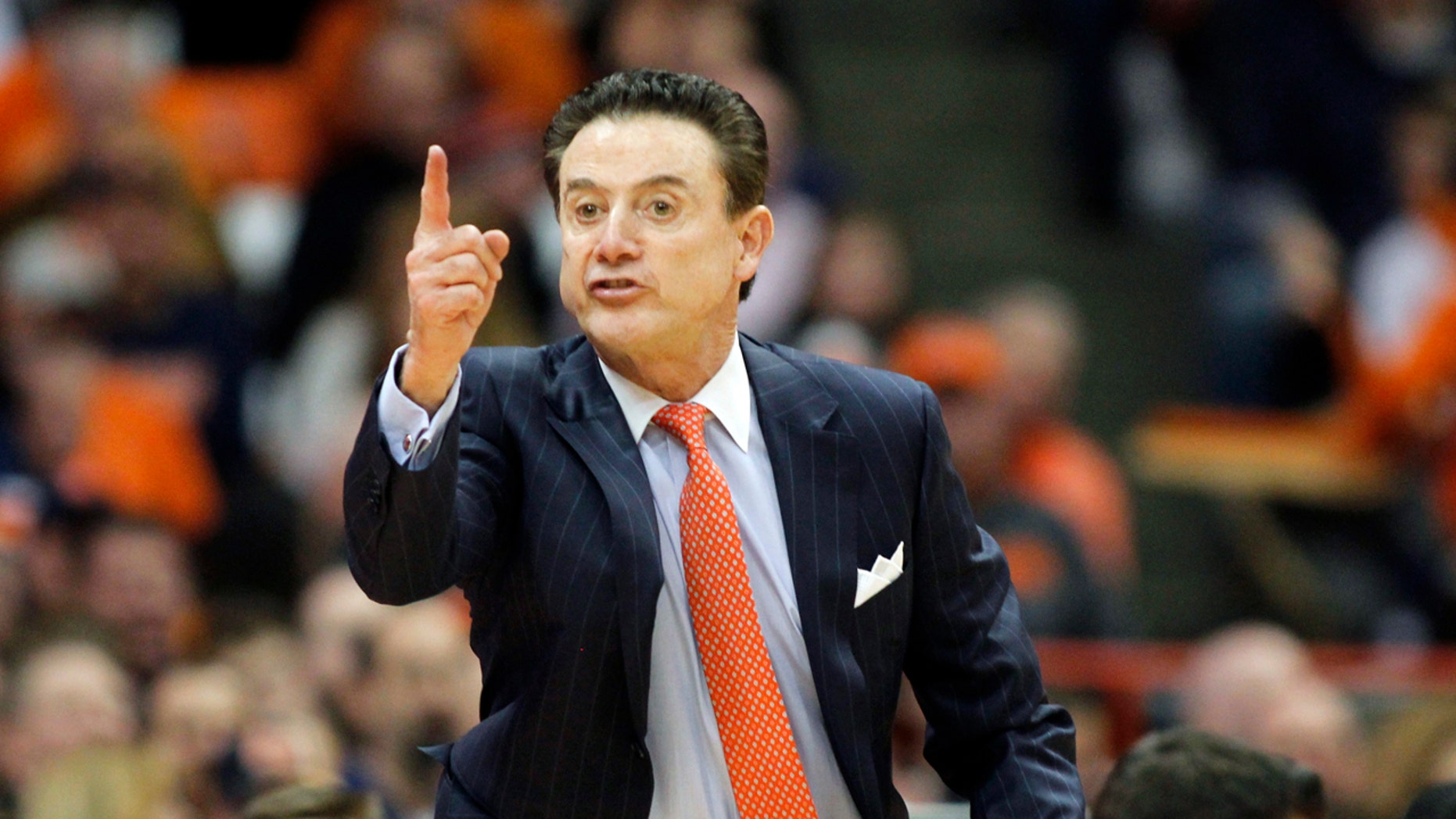 Louisville head coach Rick Pitino yells instructions to his players during an NCAA college basketball game against Syracuse on Feb. 13, 2017