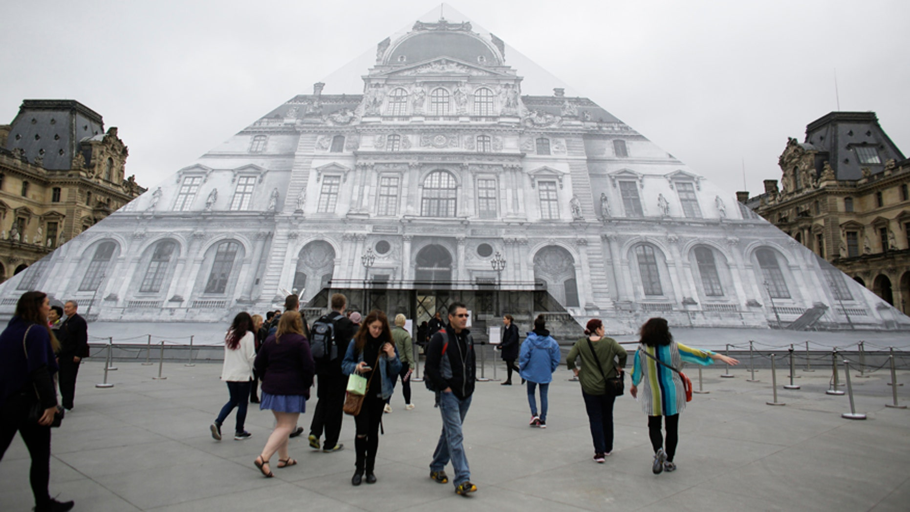 June 3, 2016: Visitors gather in front of the entrance of the Musee de Louvre which is closed and tourists being turned away, due to the unusually high water level of the nearby river Seine in Paris.