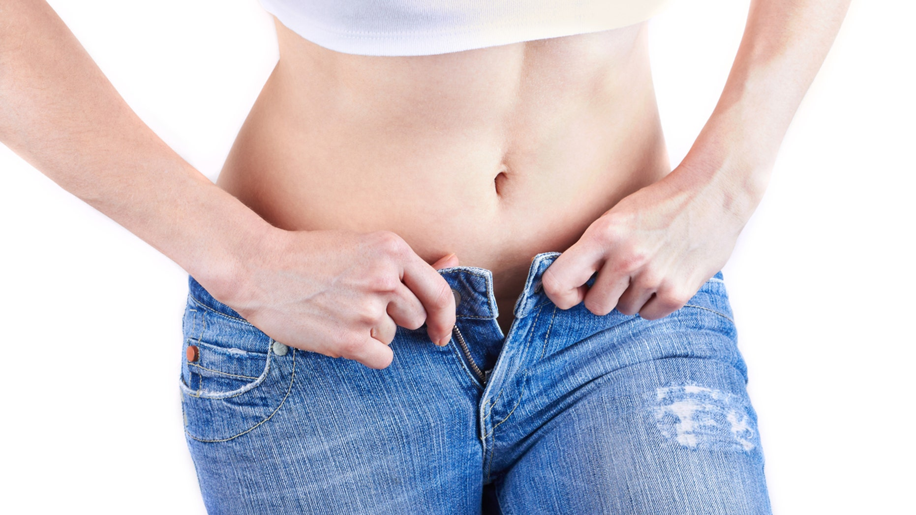 Overweight woman wearing jeans
