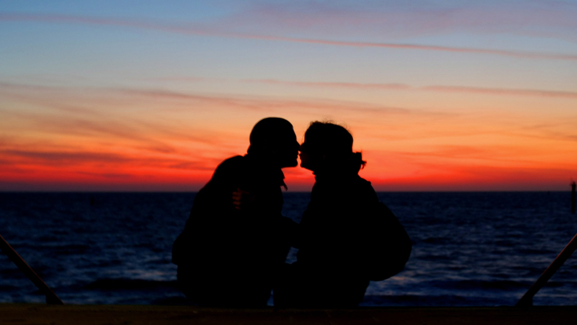 NORDERNEY, GERMANY - JULY 04:  A couple enjoys the sunset on July 4, 2009 in Norderney, Germany.  (Photo by Joern Pollex/Getty Images)
