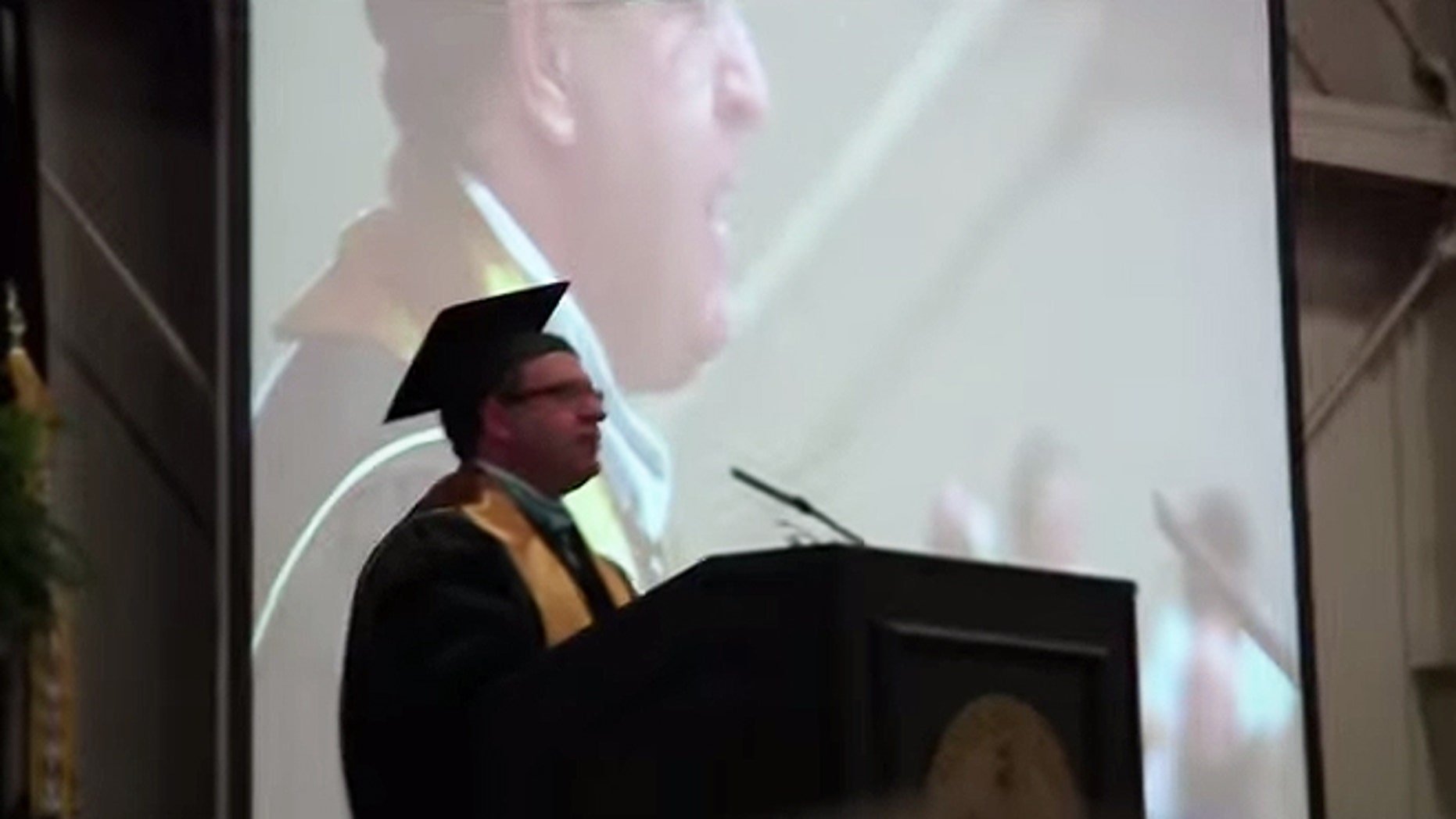 """Lebanon High School Principal Kevin Lowery reminded graduates last month that the nation's motto of """"In God We Trust"""" can be found on U.S. currency and in Francis Scott Key's 1814 version of """"The Star-Spangled Banner."""" Lowery also noted during the May 23 commencement that even though """"God is reflected in the very fabric"""" of the nation, it would be inappropriate and even illegal to mention God or say a prayer at the ceremony. (YouTube)"""