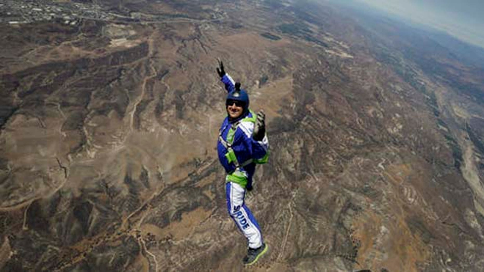 Skydiver Luke Aikins smiles as he jumps from a helicopter during his training in Simi Valley, Calif.  (AP Photo/Jae C. Hong)