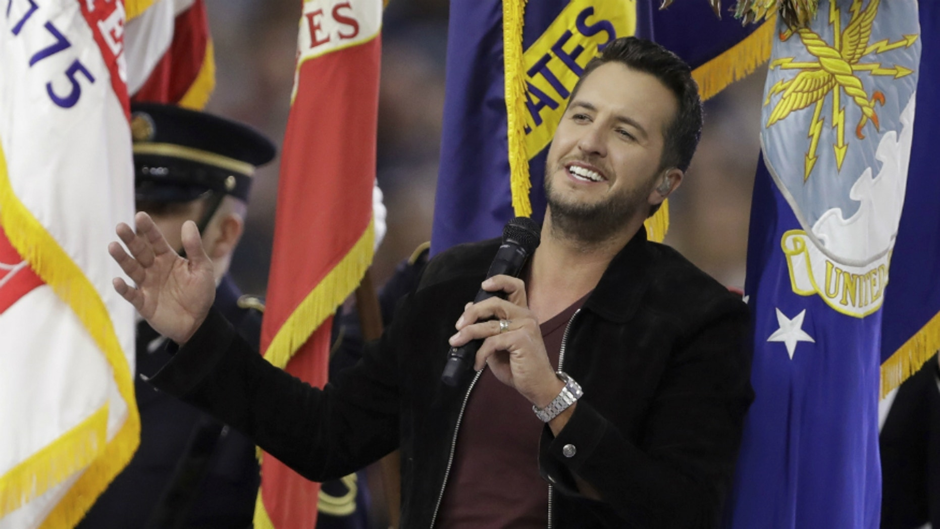 Country music singer Luke Bryan sings the National Anthem, before the NFL Super Bowl 51 football game between the New England Patriots and the Atlanta Falcons, Sunday, Feb. 5, 2017, in Houston.