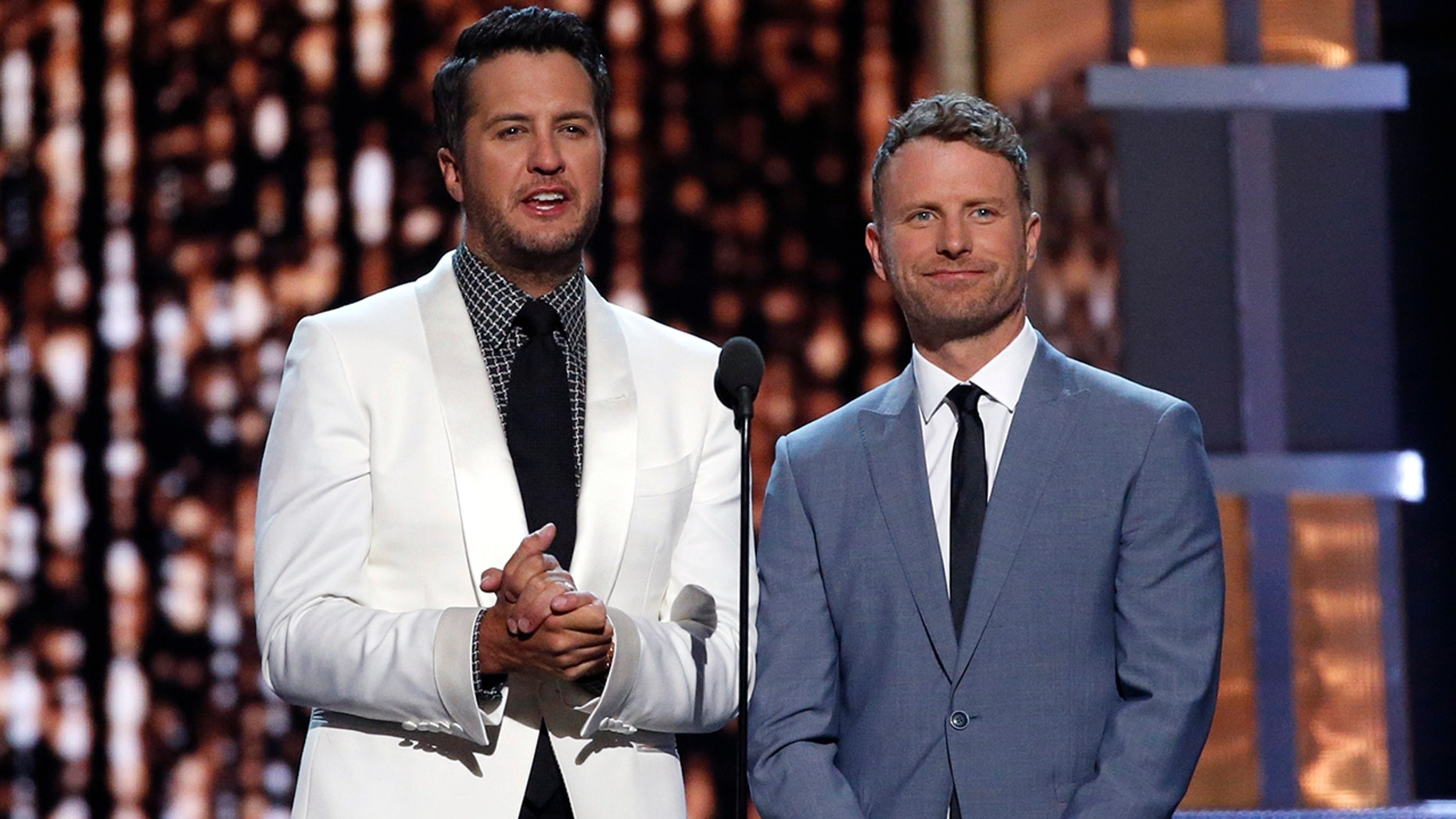 Luke Bryan (L) and Dierks Bentley host the 52nd Academy of Country Music Awards in Las Vegas, Nevada on April 2, 2017.
