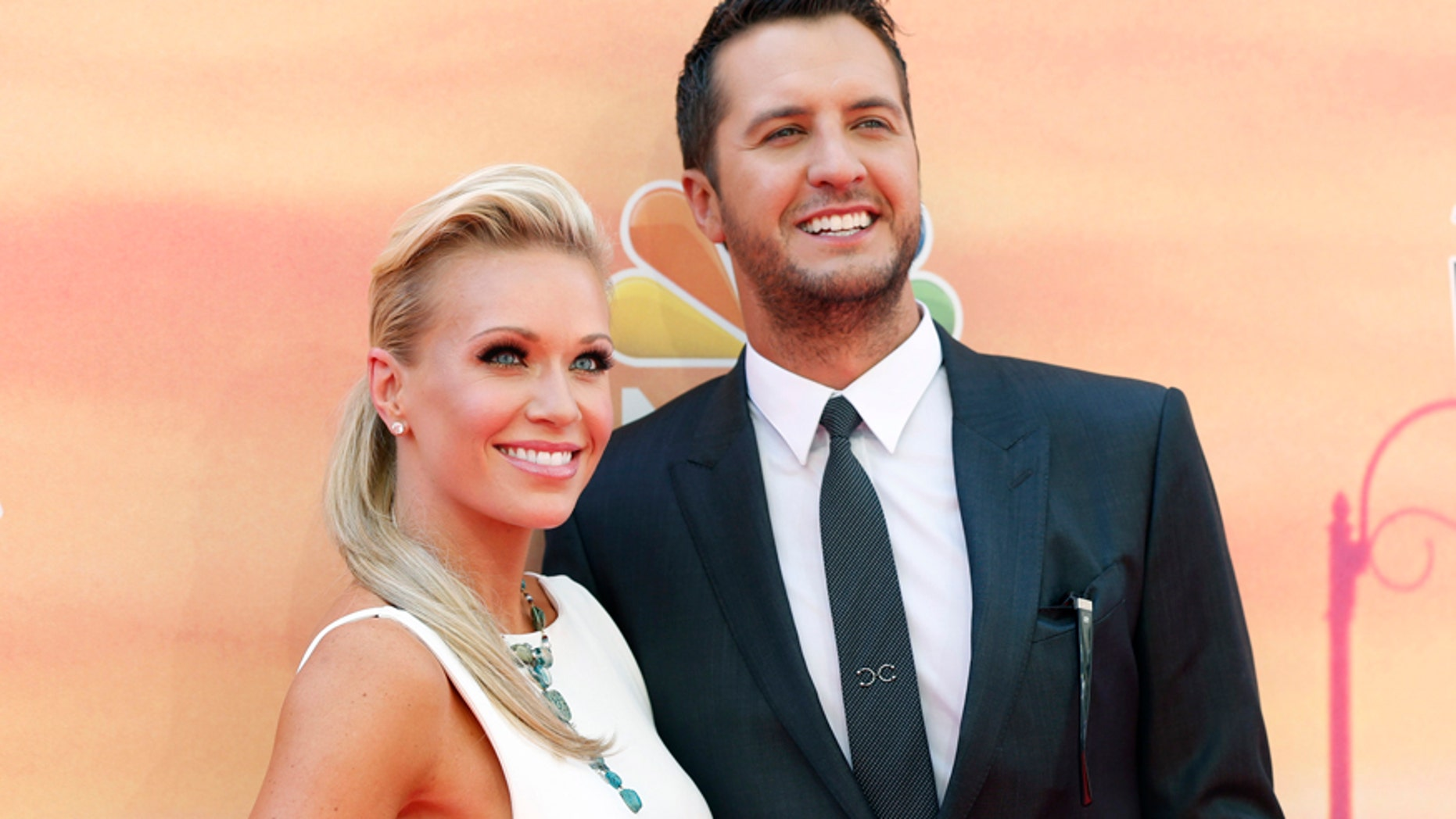 Country music recording artist Luke Bryan and his wife Caroline arrive at the iHeartRadio Music Awards in Los Angeles, California May 1, 2014.
