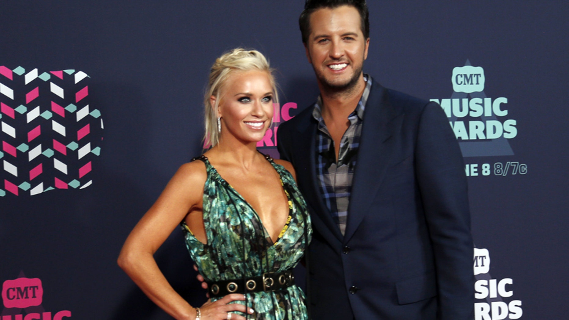 Singer Luke Bryan and wife, Caroline Boyer, arrive at the 2016 CMT Music Awards in Nashville, Tennessee, U.S. June 8, 2016.