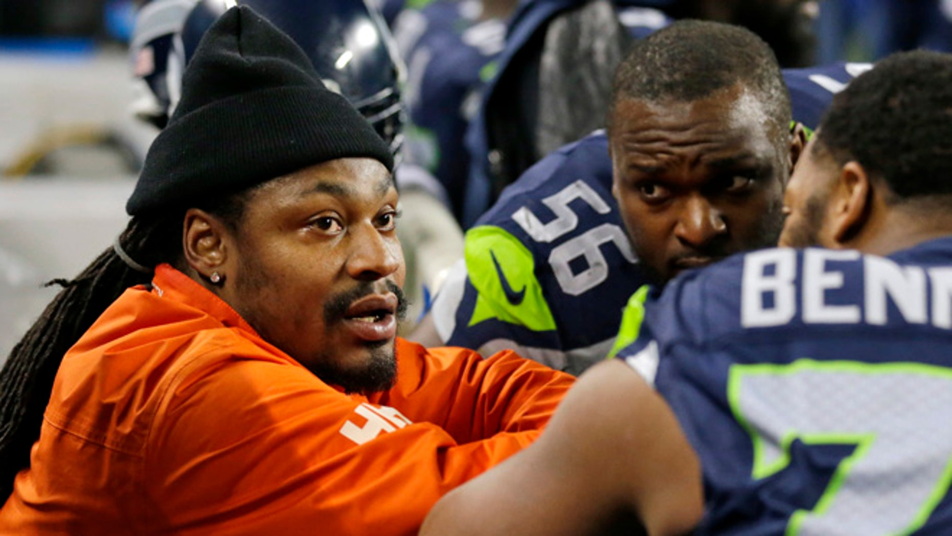 In this Dec. 4, 2016, file photo, retired Seattle Seahawks running back Marshawn Lynch, left, chats on the sidelines players on the bench in the second half of an NFL football game against the Carolina Panthers in Seattle.