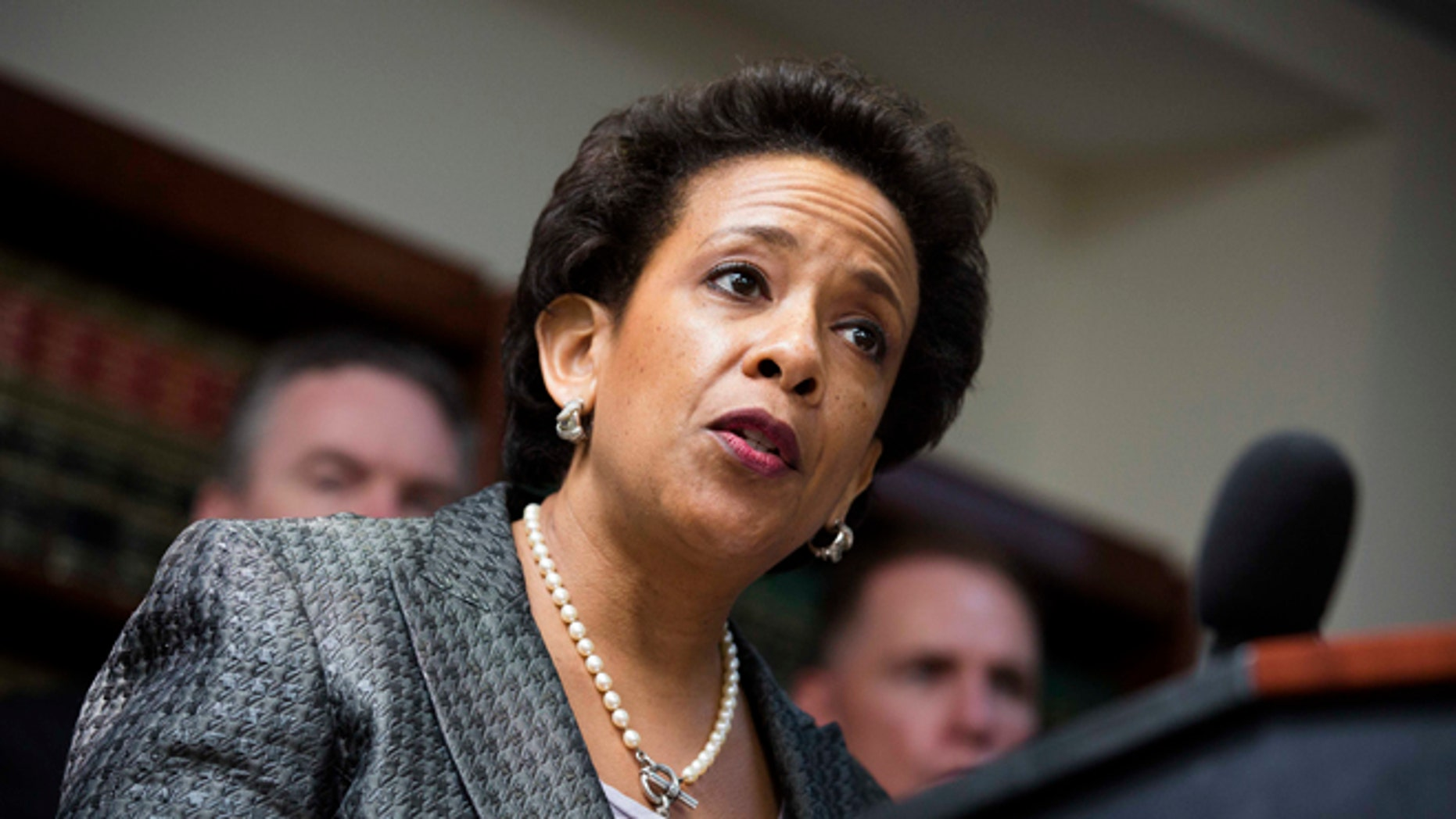 In this June 17, 2013 file photo, Loretta Lynch, U.S. attorney for the Eastern District of New York, speaks during a news conference in Brooklyn.