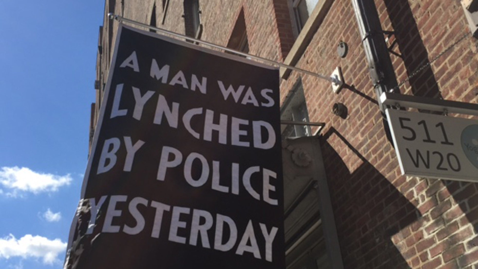 The art gallery's banner is stirring controversy, especially in the wake of last week's murder of five Dallas police officers. (FoxNews.com)