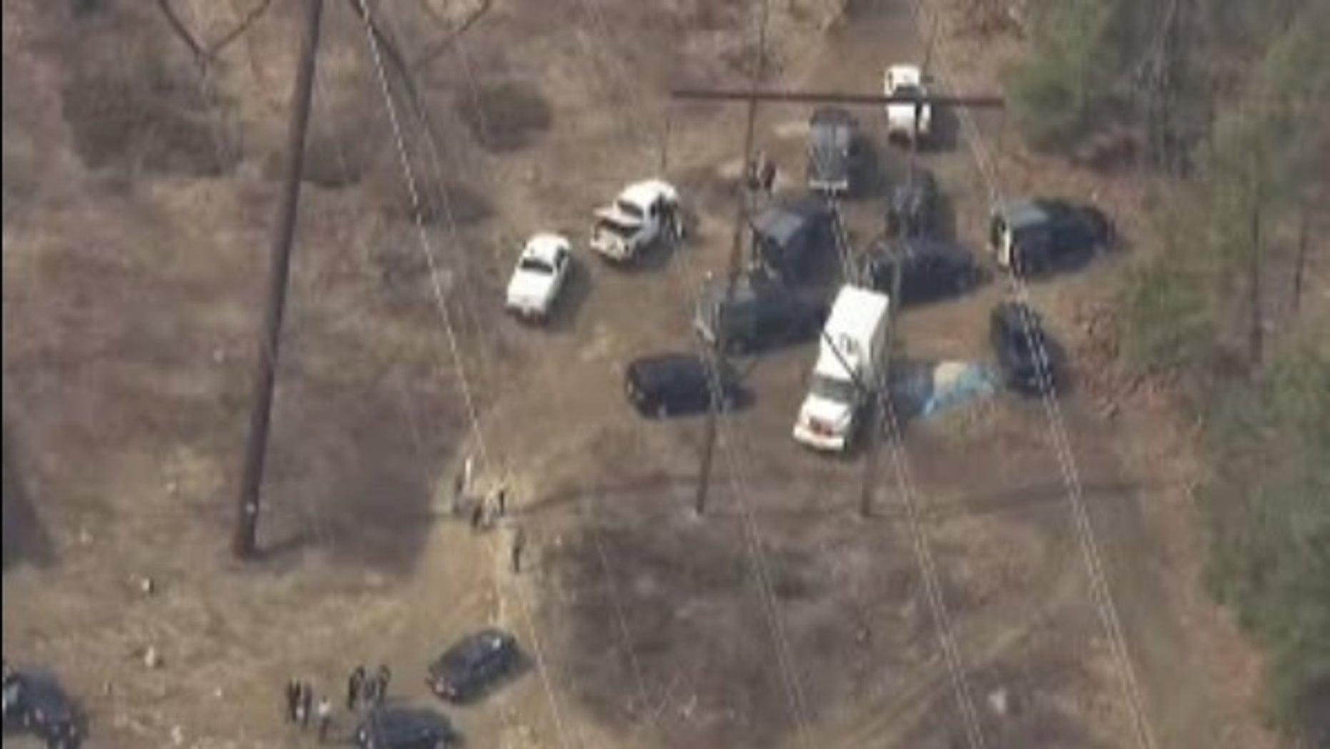 Investigators at the scene where the devices were found.
