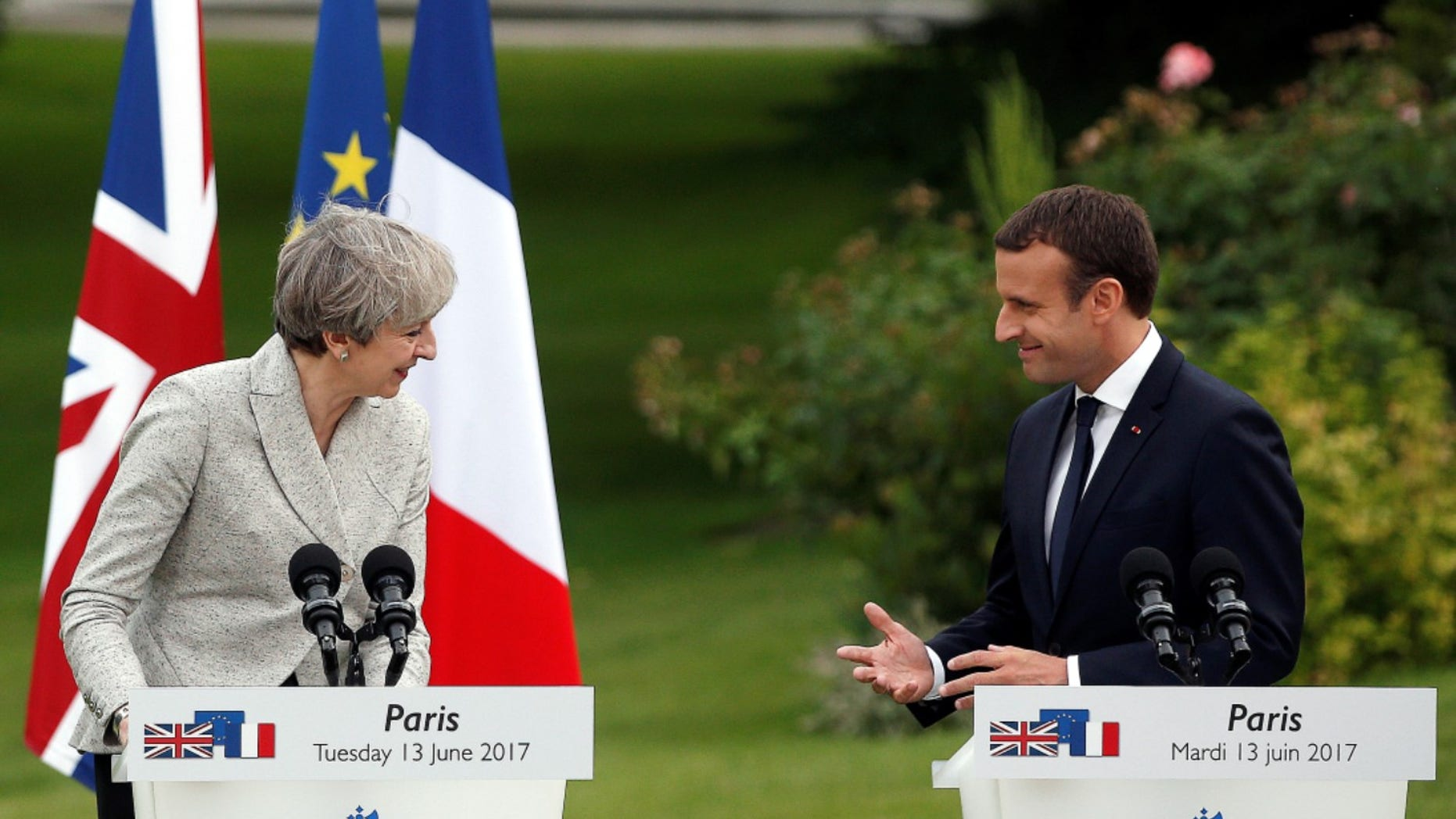French President Emmanuel Macron, right, and Britain's Prime Minister Theresa May, spoke at a joint press conference, after a meeting, at the Elysee Palace, in Paris, Tuesday, June 13, 2017. (AP Photo/Thibault Camus)